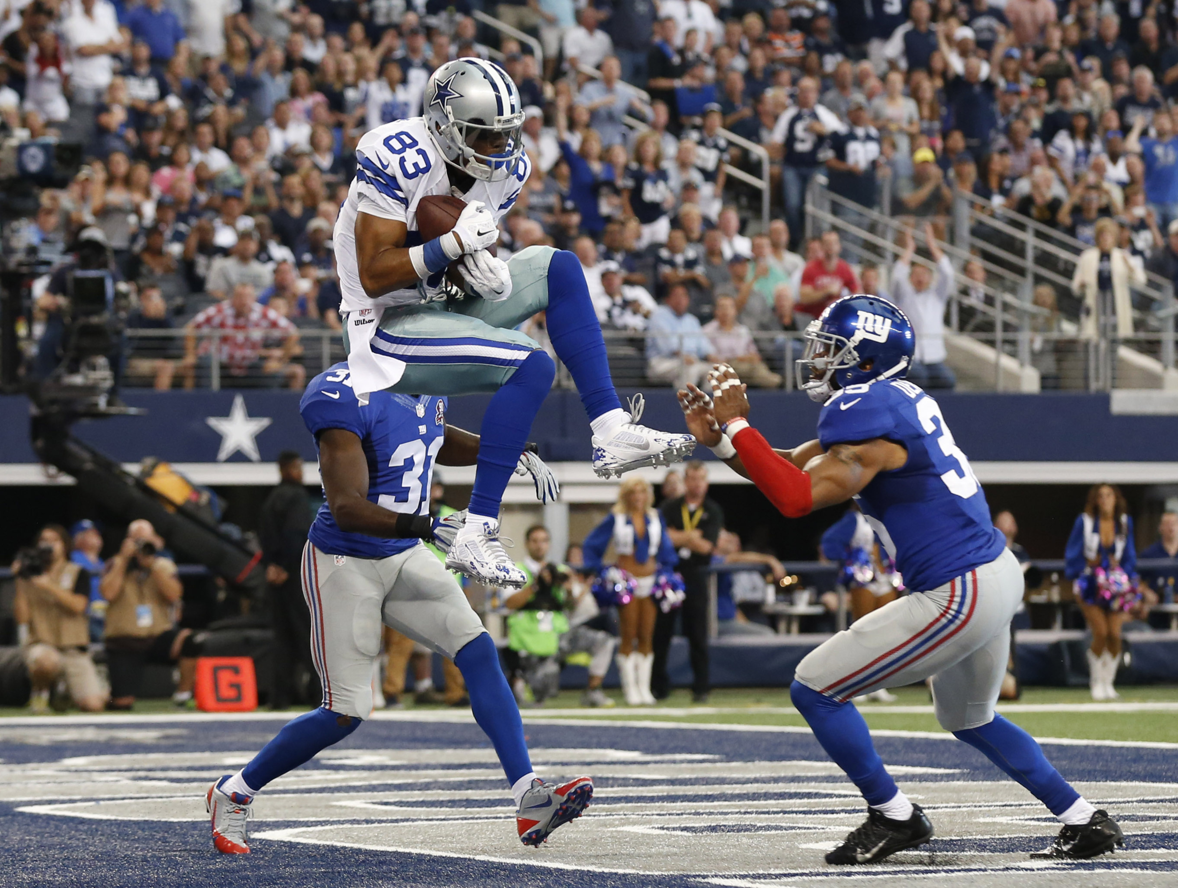 Terrance Williams catches a touchdown pass for Dallas