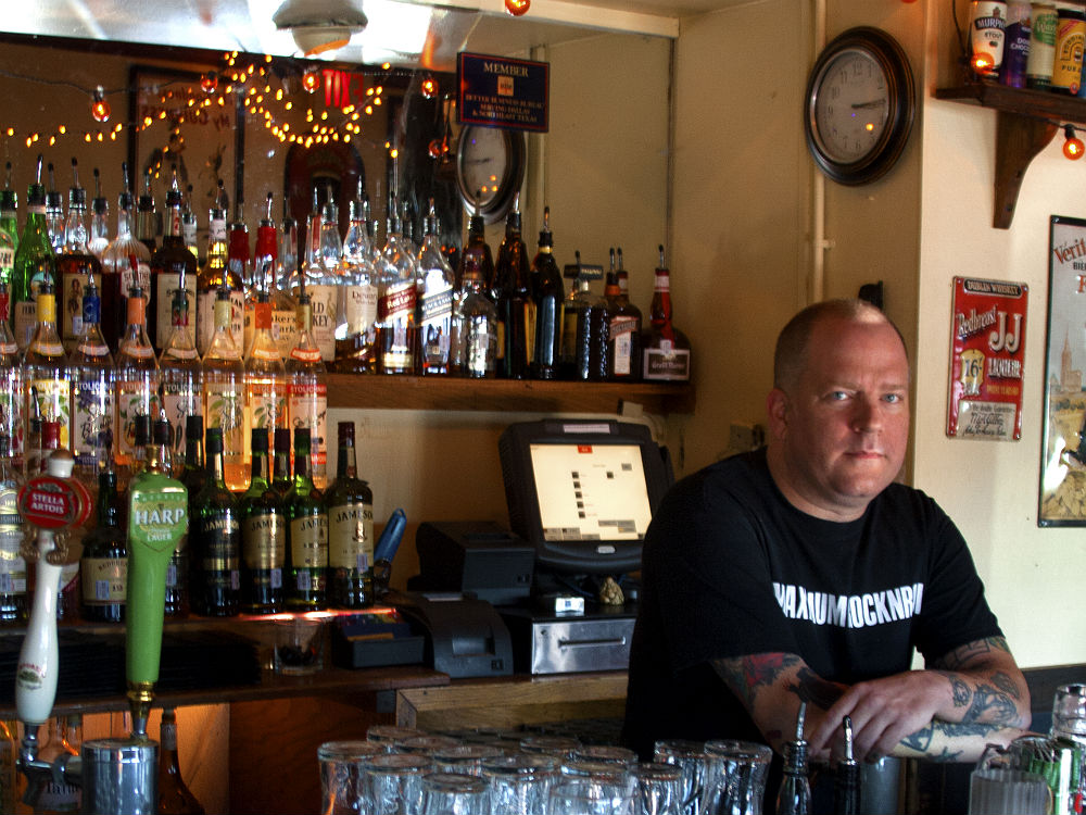 Mick Wallace behind the bar at The Dubliner.