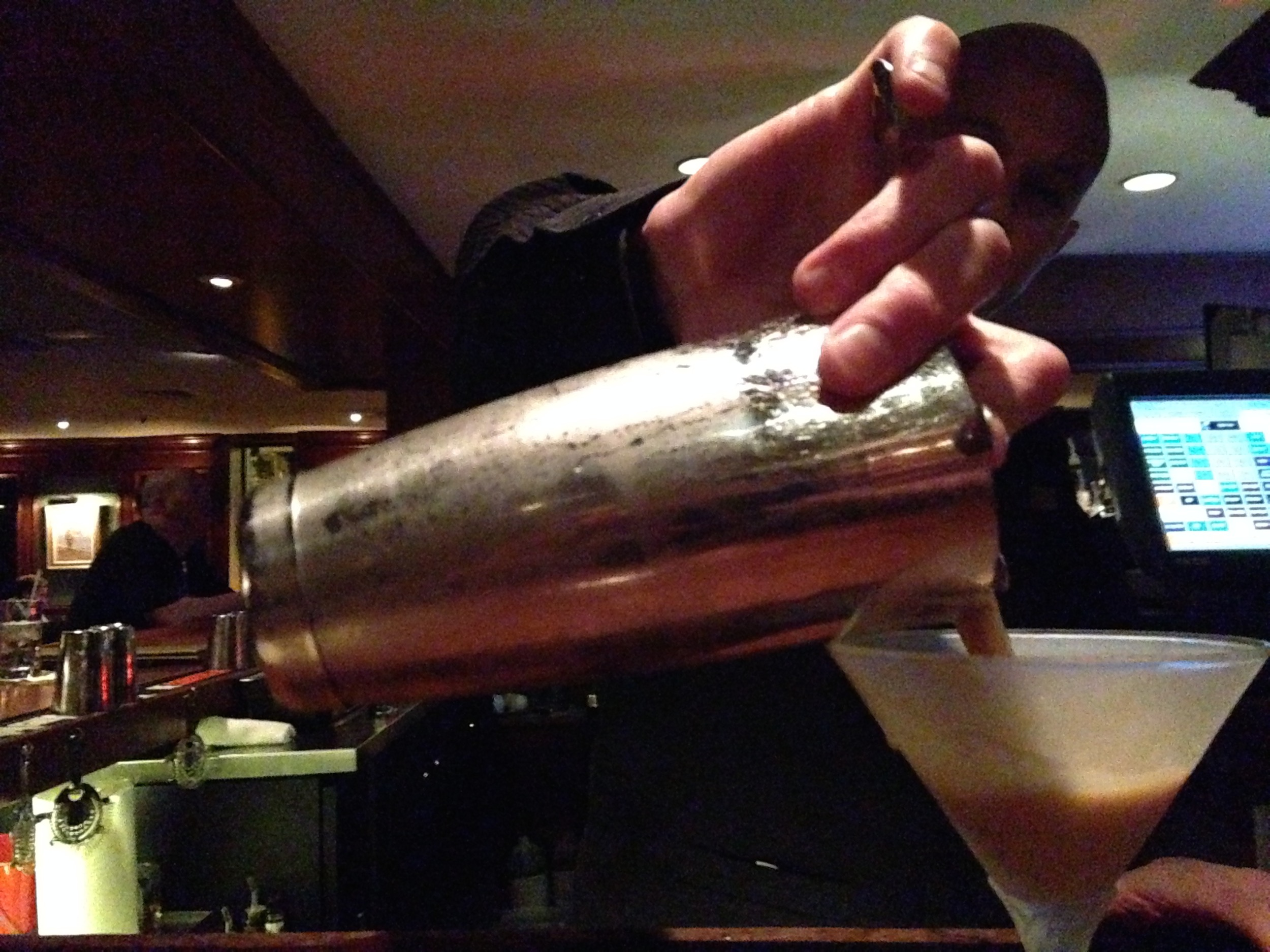 Bartender Ben Bragdon pours an Espresso Martini, probably The Armory's most popular cocktail.