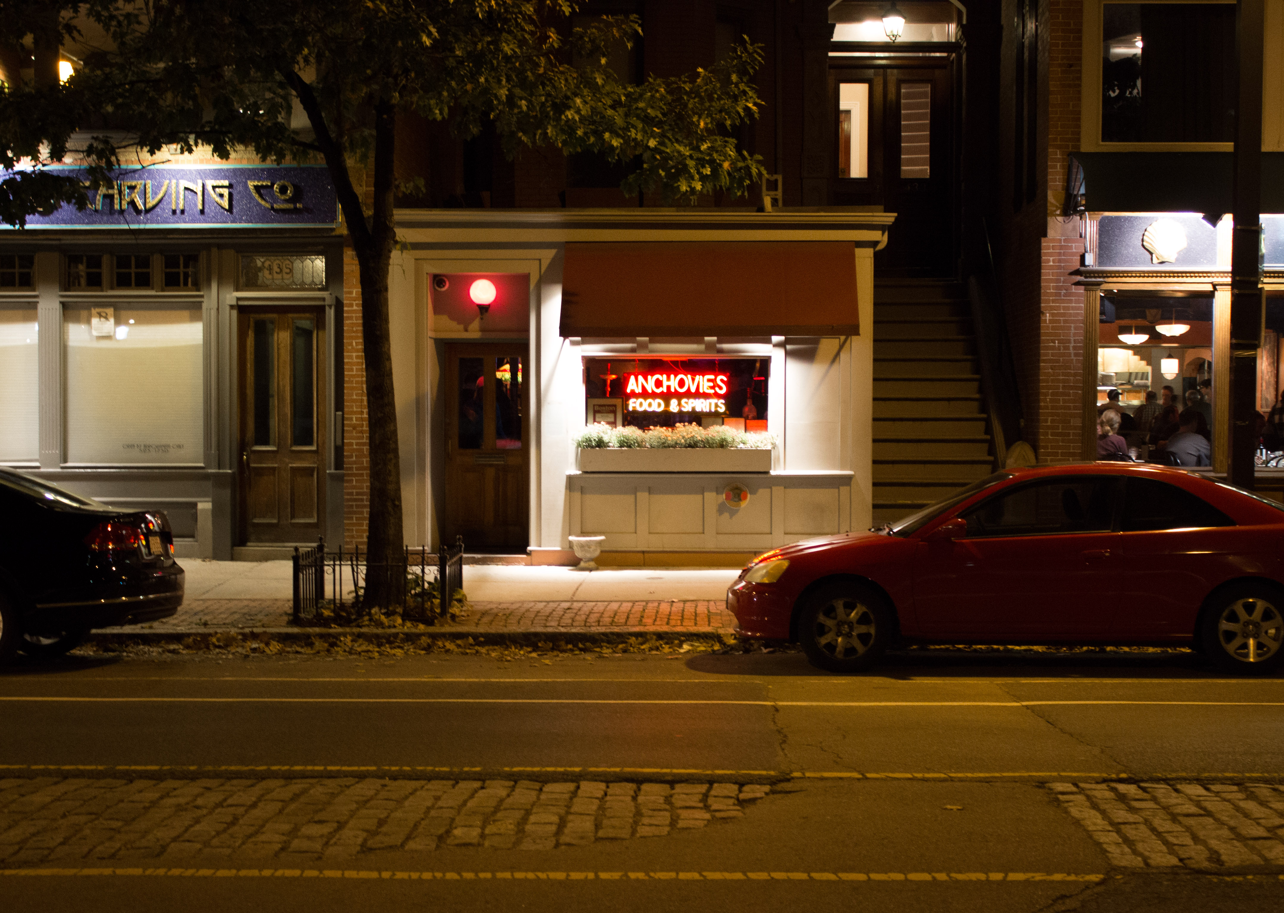 The exterior of Anchovies in the South End, shot from across the street after dark