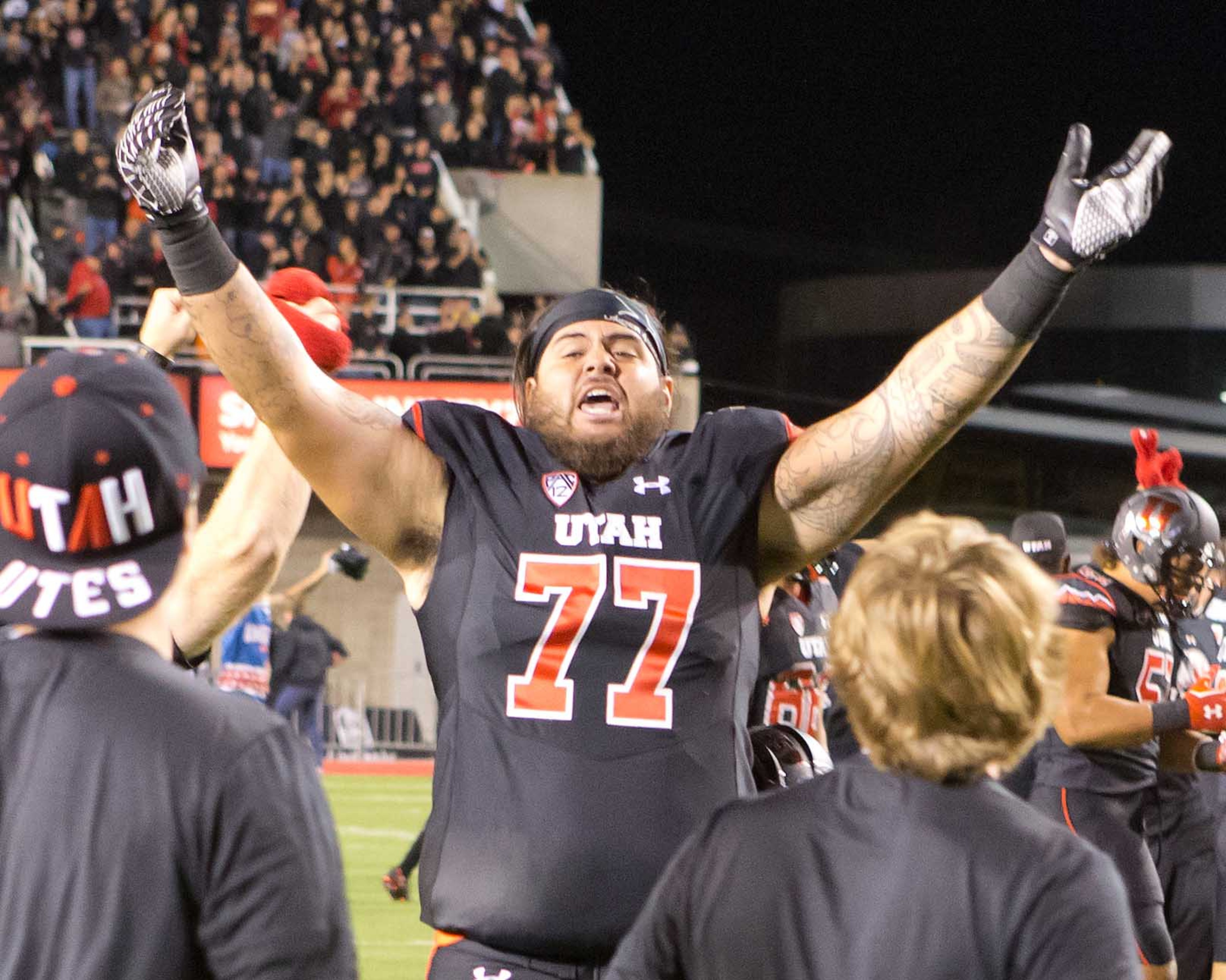 Offensive lineman Mark Pouvave celebrates Utah's rise in the polls after beating USC 24-21.
