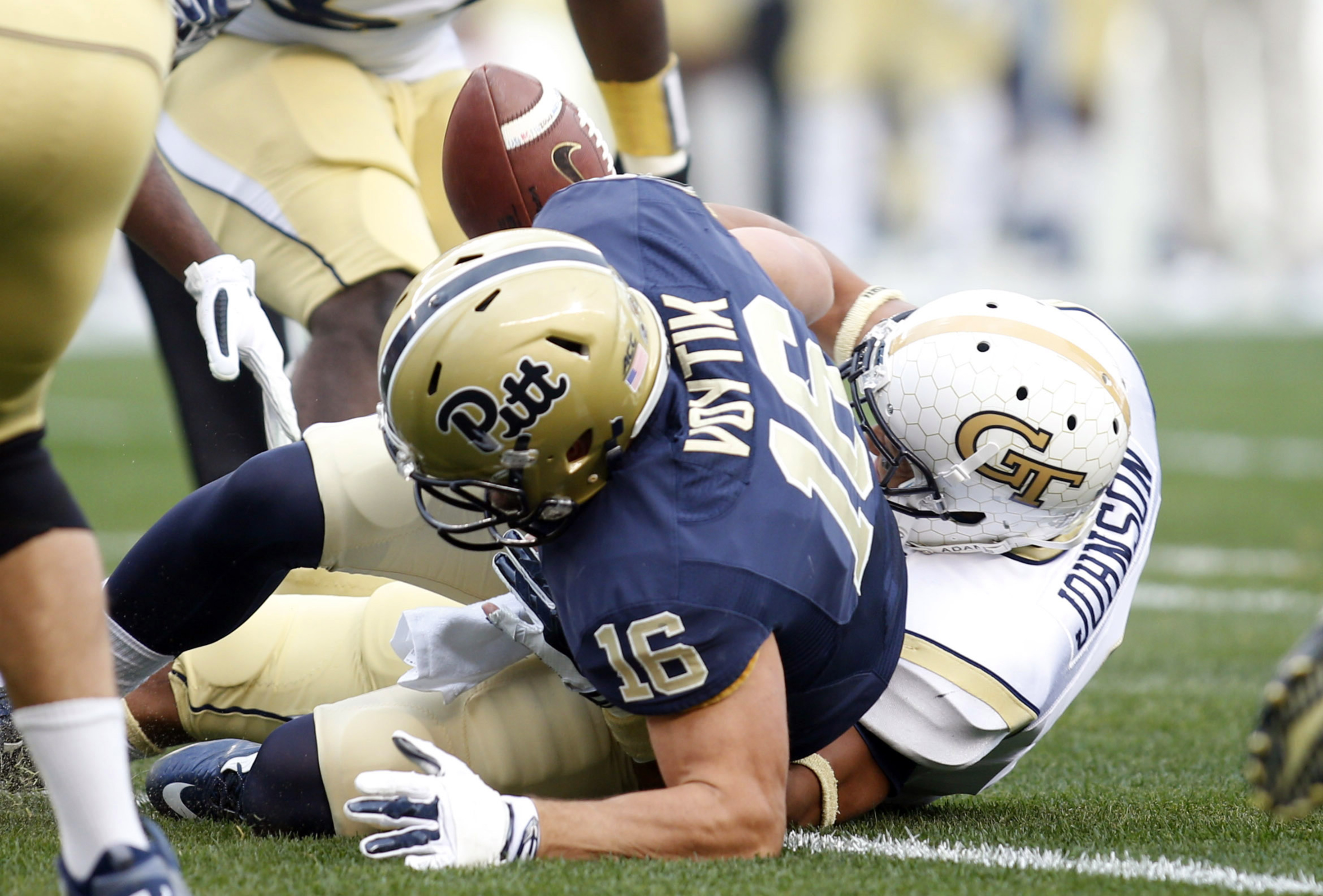 Isaiah Johnson of Georgia Tech forcing a Chad Voytik fumble