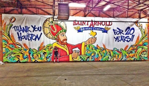 Graffiti artist Gonzo 247 with Saint Arnold mural