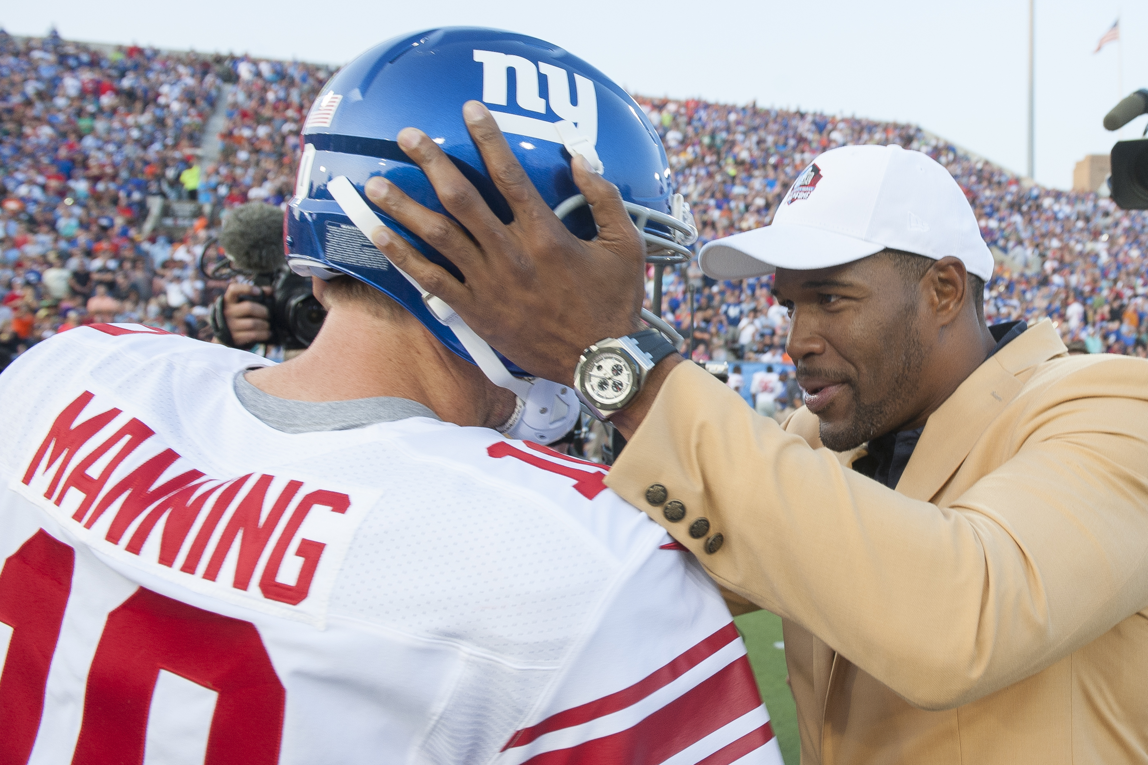 Eli Manning and Michael Strahan at the Hall of Fame Game.