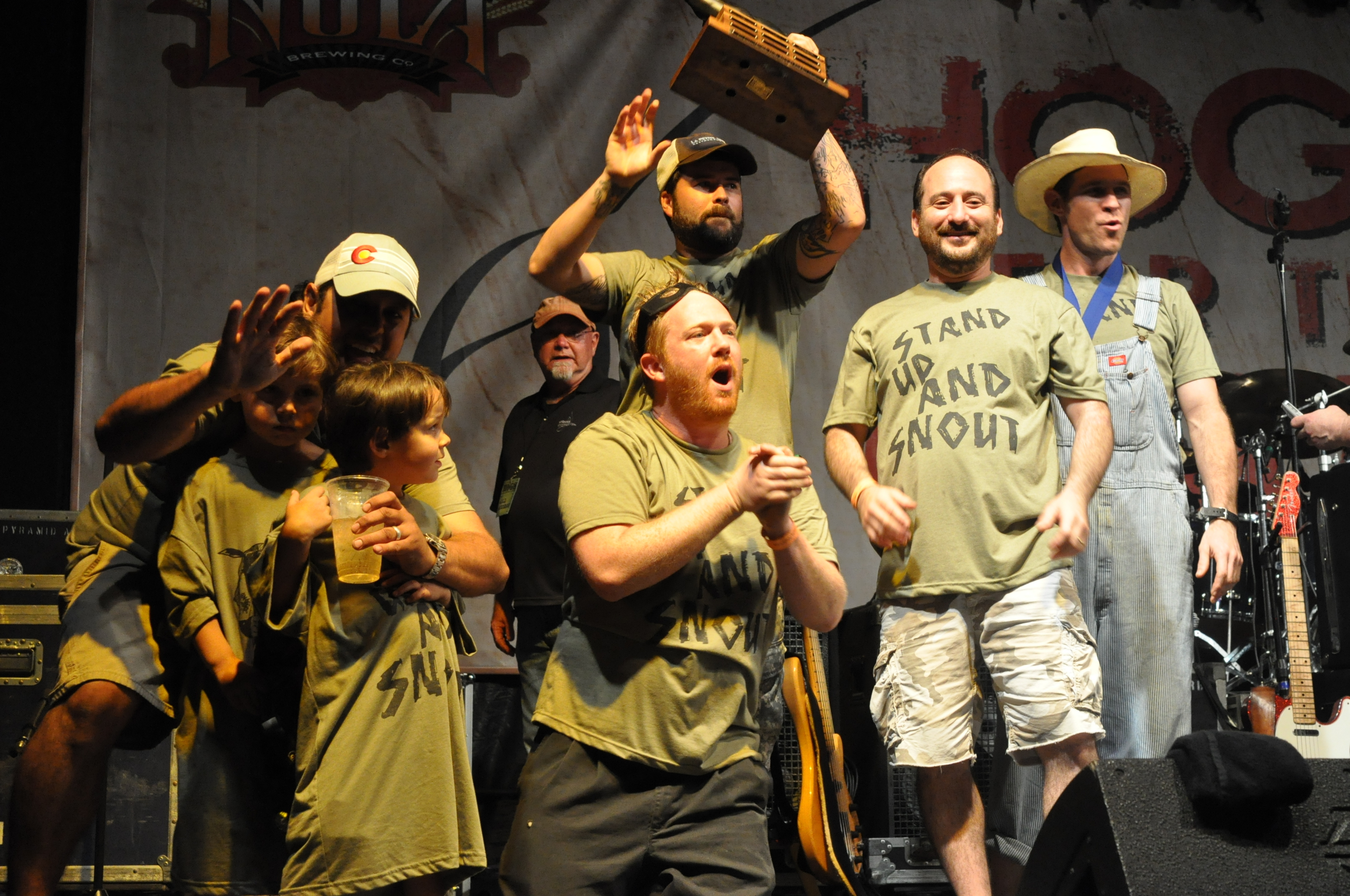 The Stand Up and Snout crew, receiving their Grand Champion award at 2013's Hogs for the Cause