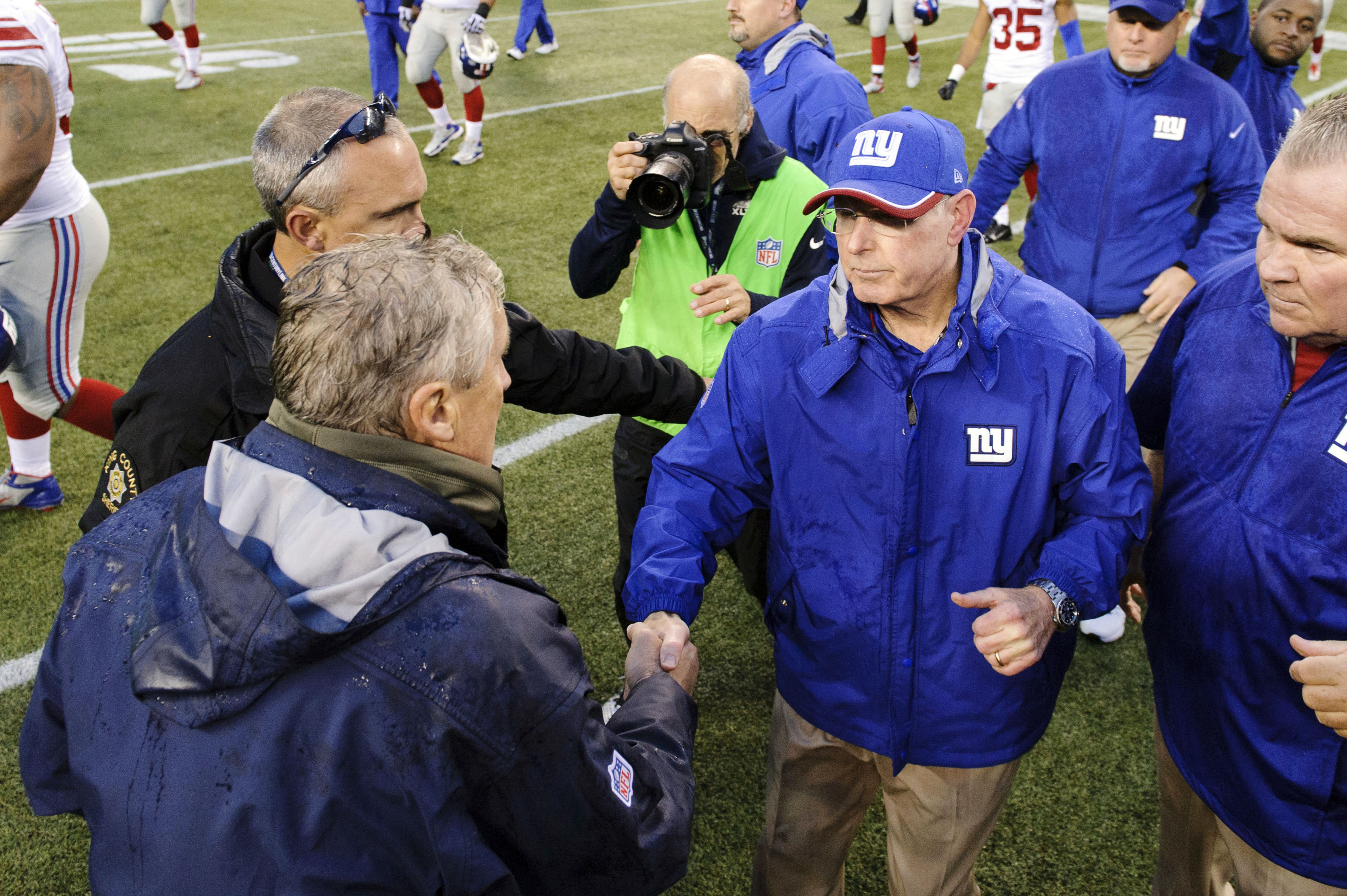 Tom Coughlin (right) shakes hands with Pete Carroll after Sunday's game.