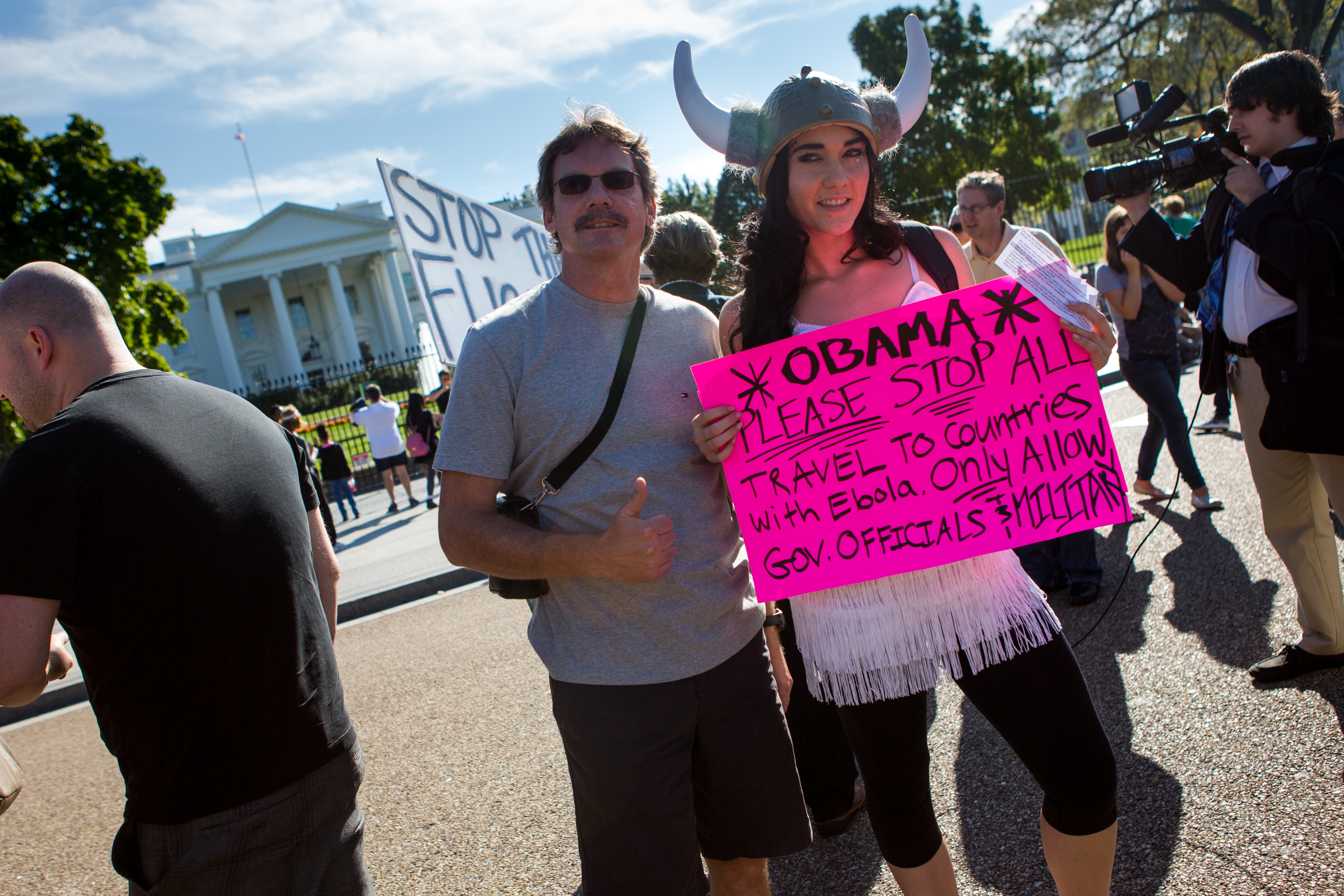 Protestors hold up a sign in front of the White House asking to bar air travel from the Ebola hot zone.