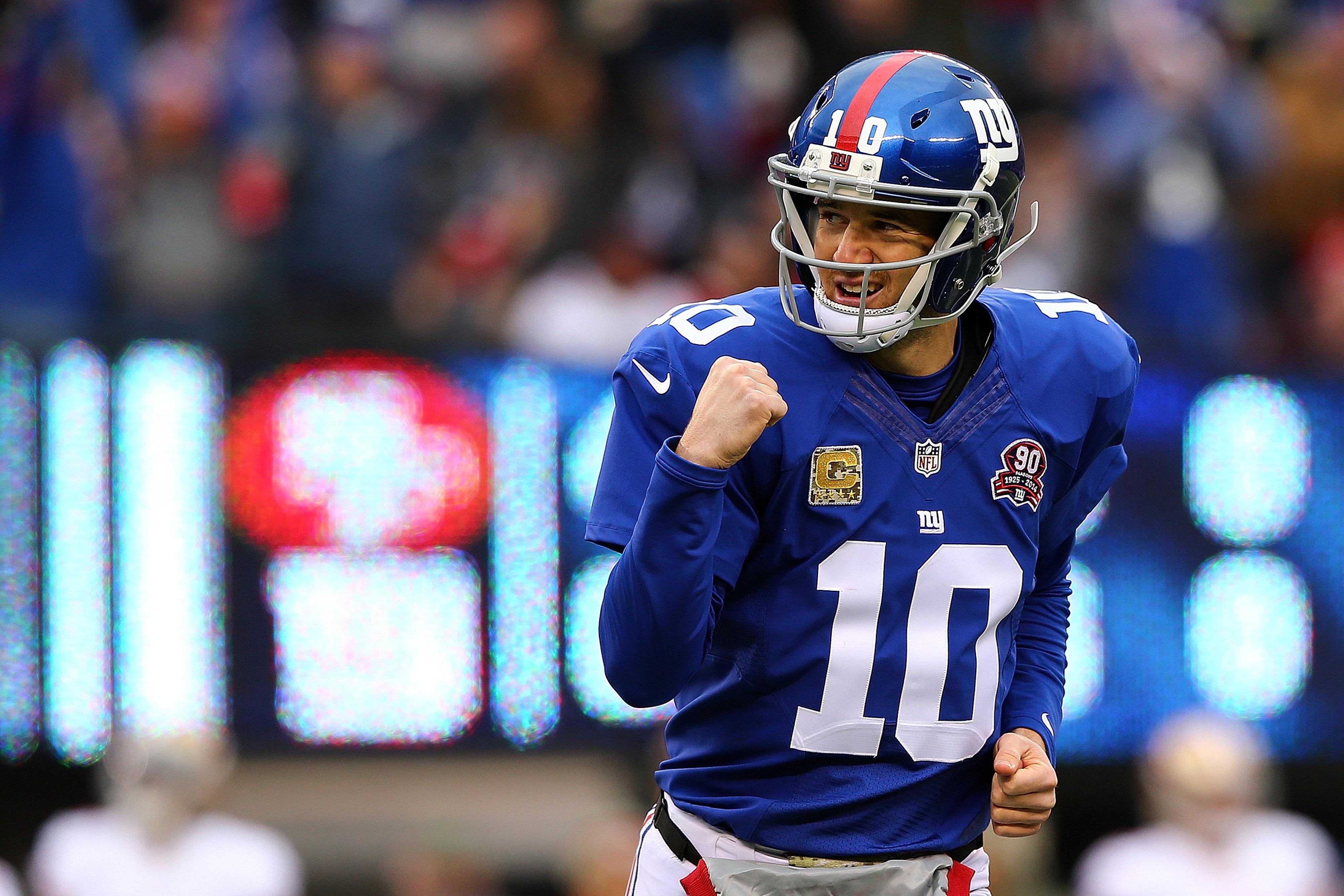 Eli Manning celebrates a first-quarter touchdown pass