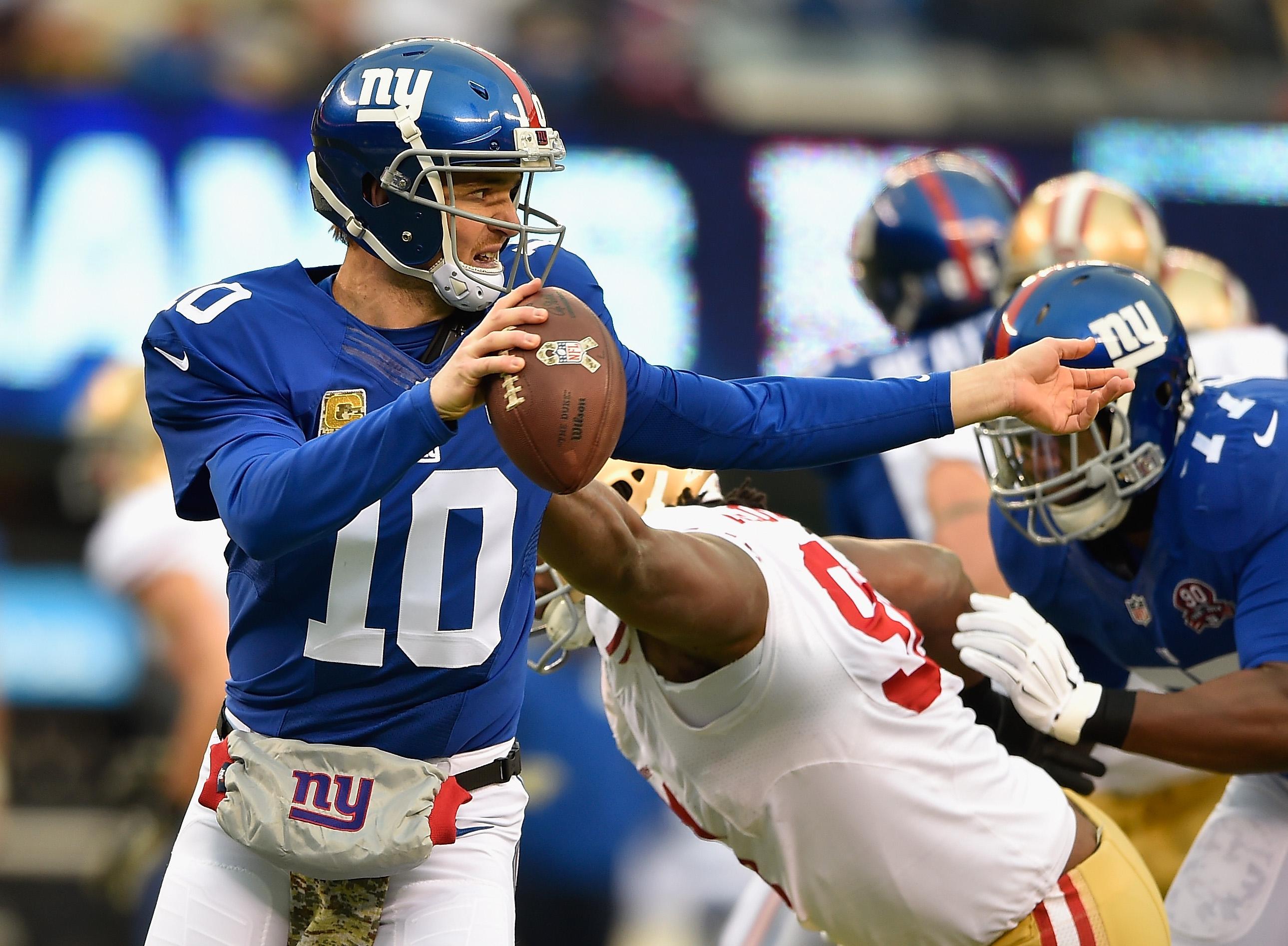 Eli Manning evades the pass rush on Sunday