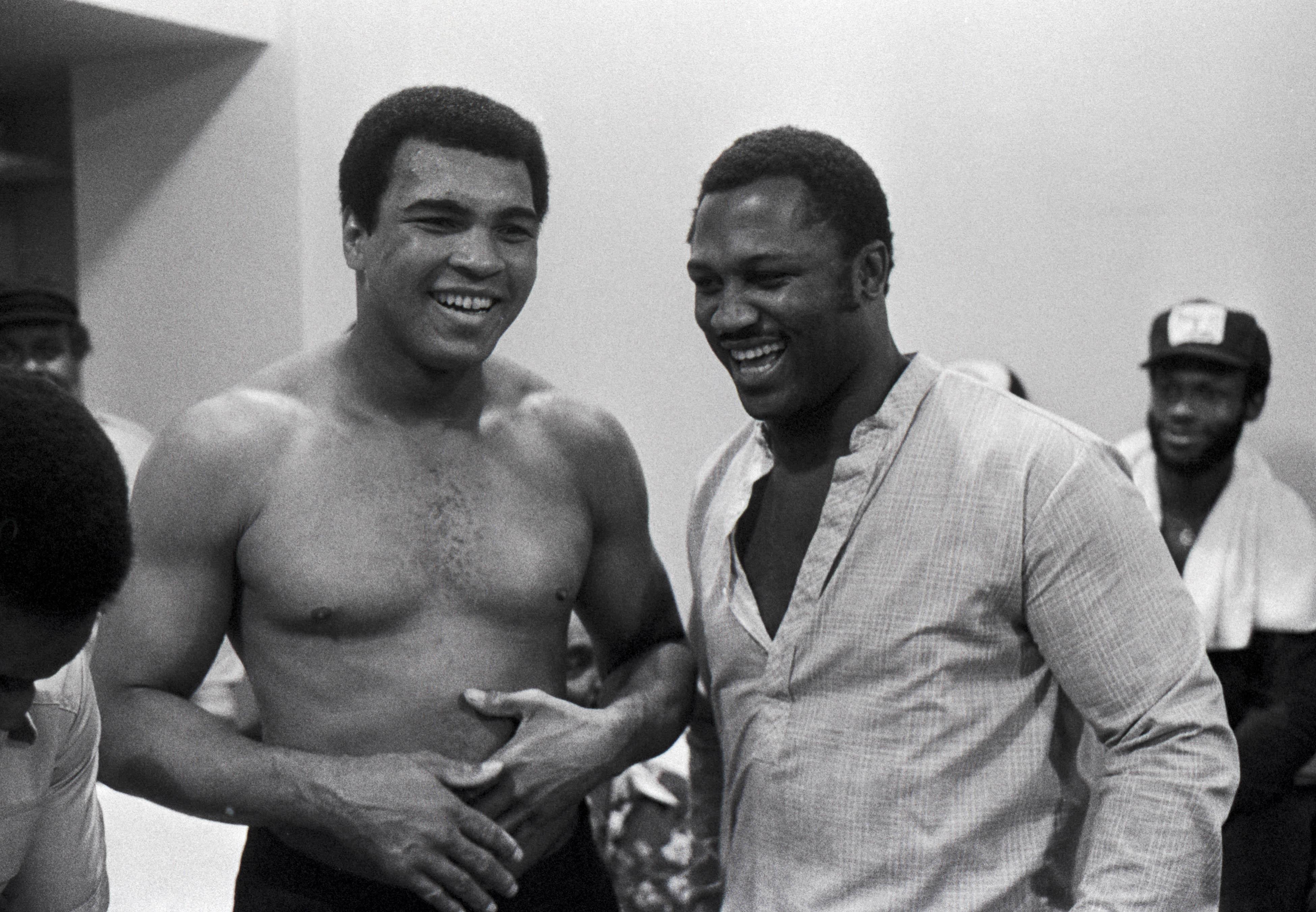 Muhammad Ali and Joe Frazier share a Husky joke