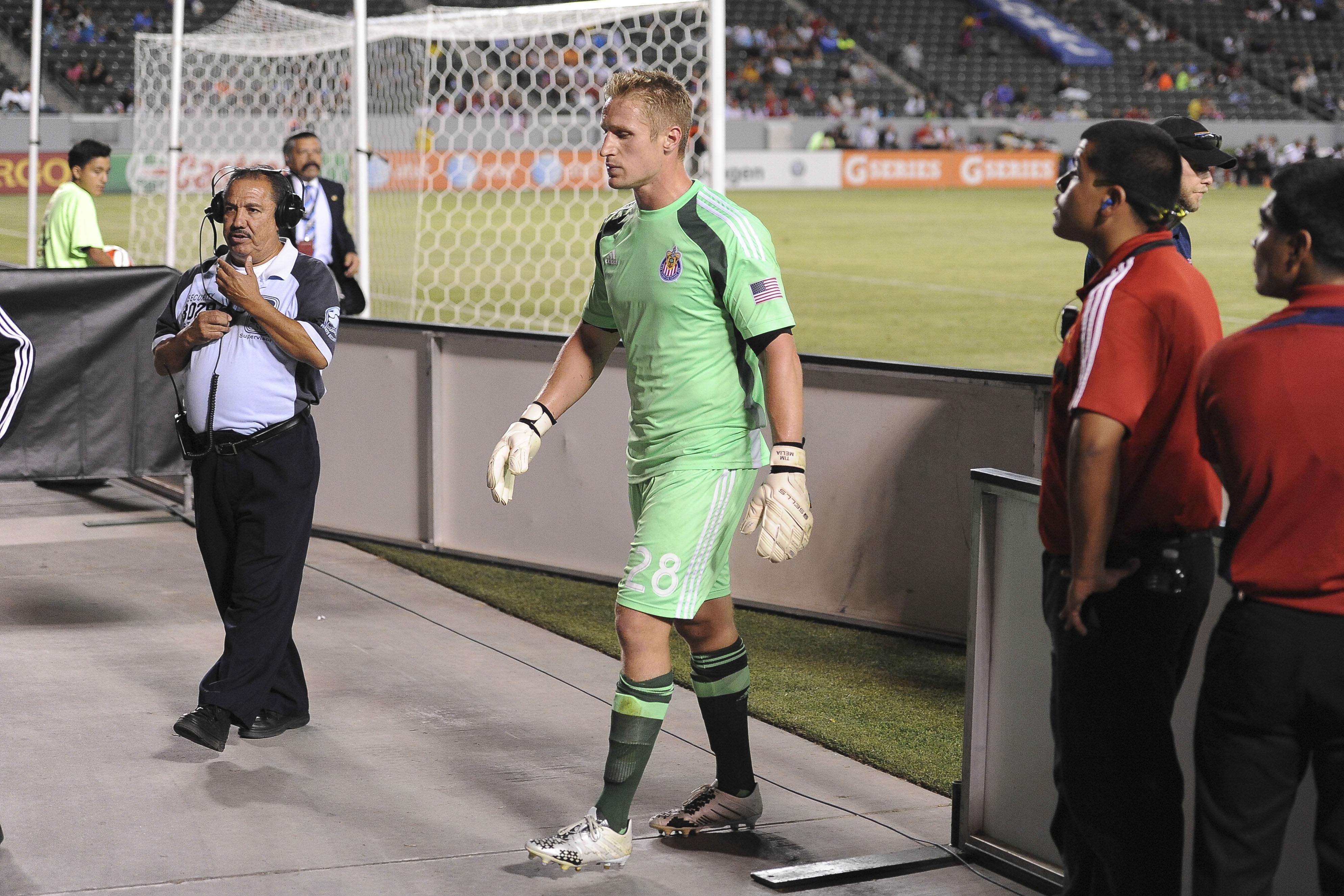 Melia exits the field, Chivas USA.