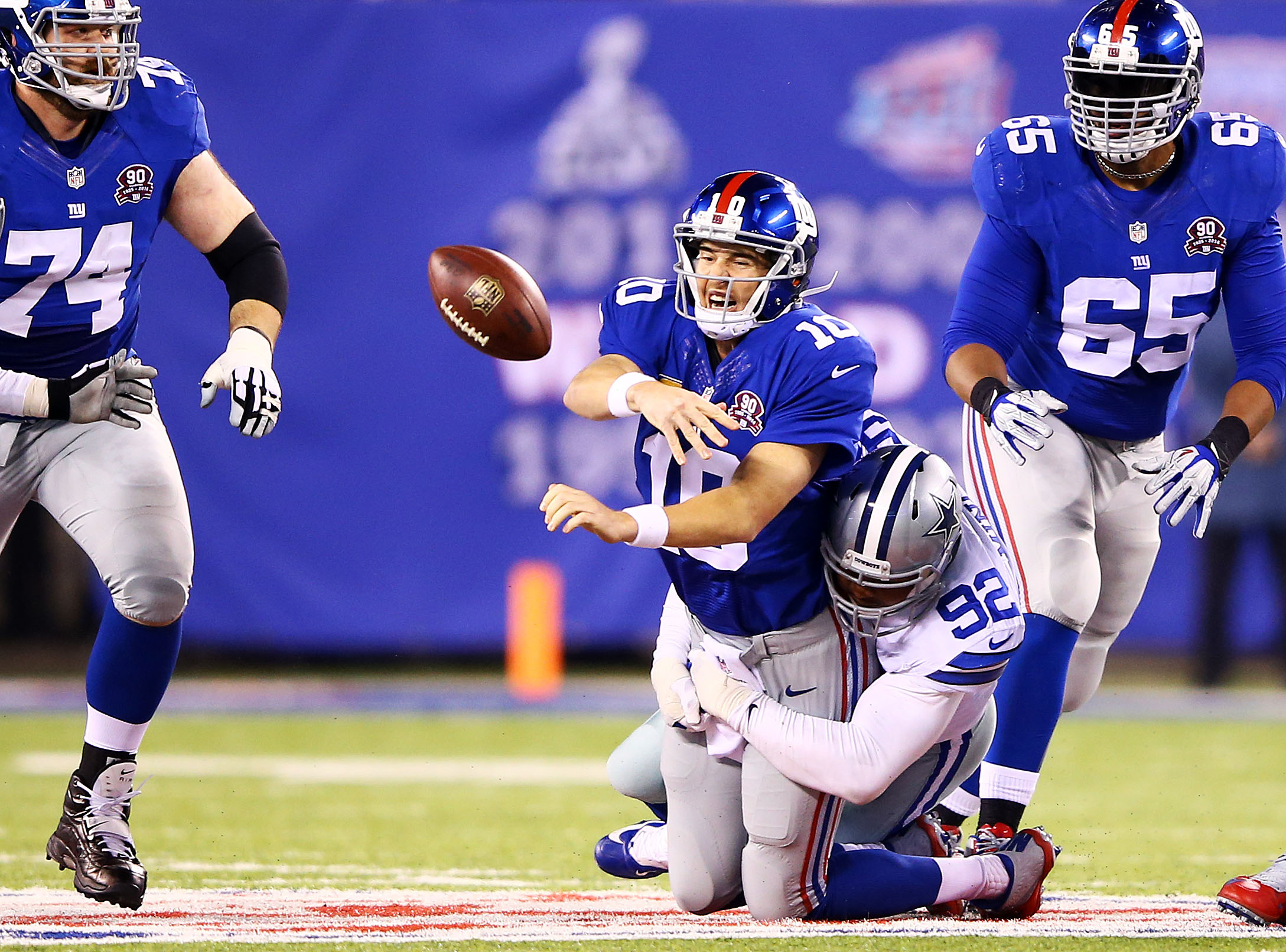 Eli Manning is sacked by Jerome Mincey in the second quarter