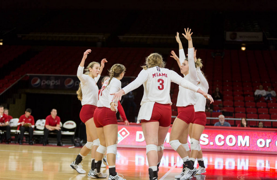 The Miami Redhawks Volleyball team celebrates a point in their semifinal victory over Northern Illinois in the 2014 MAC Volleyball tournament.
