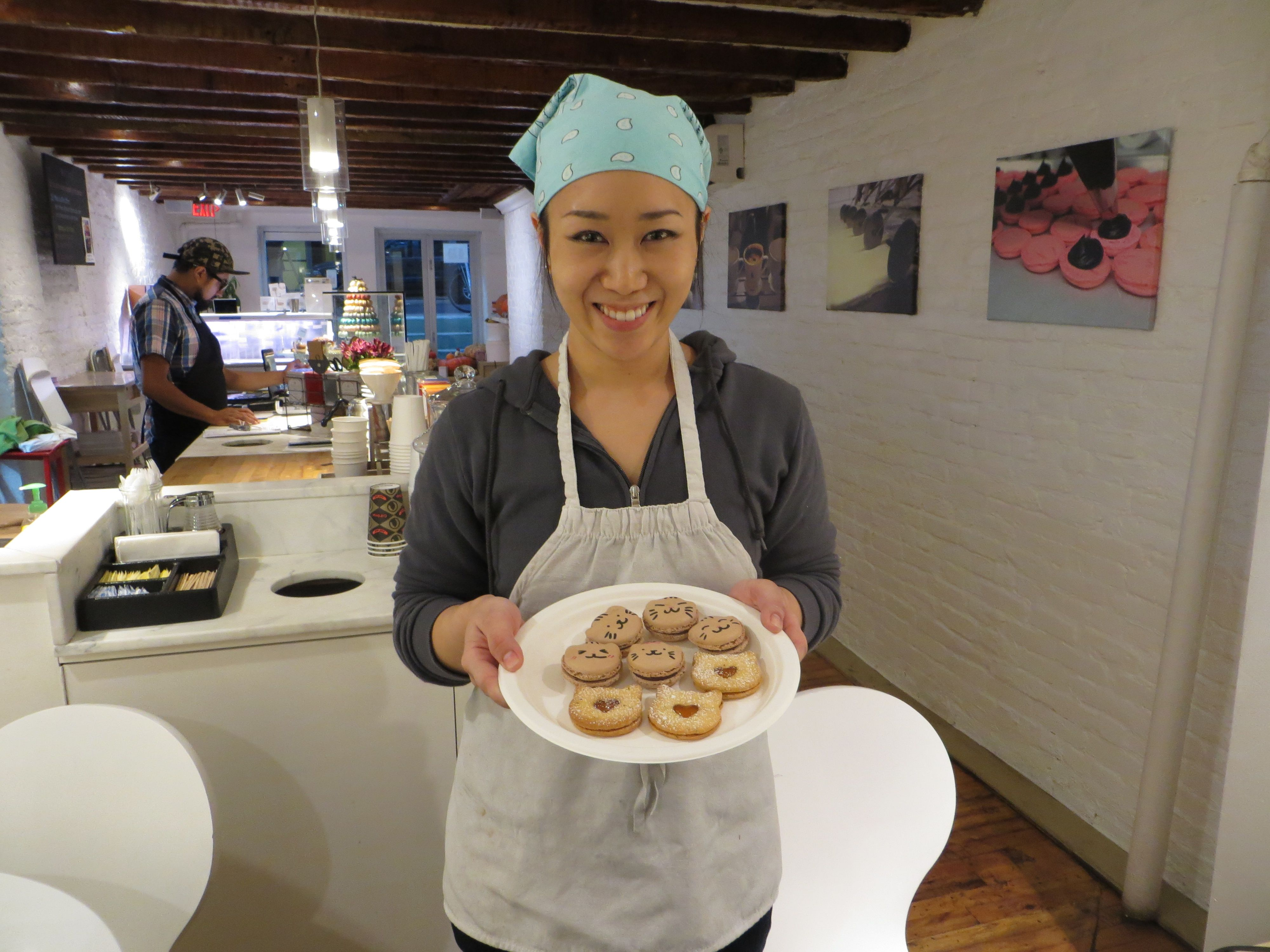 Christina Ha, with a few of her cat-themed cookies.