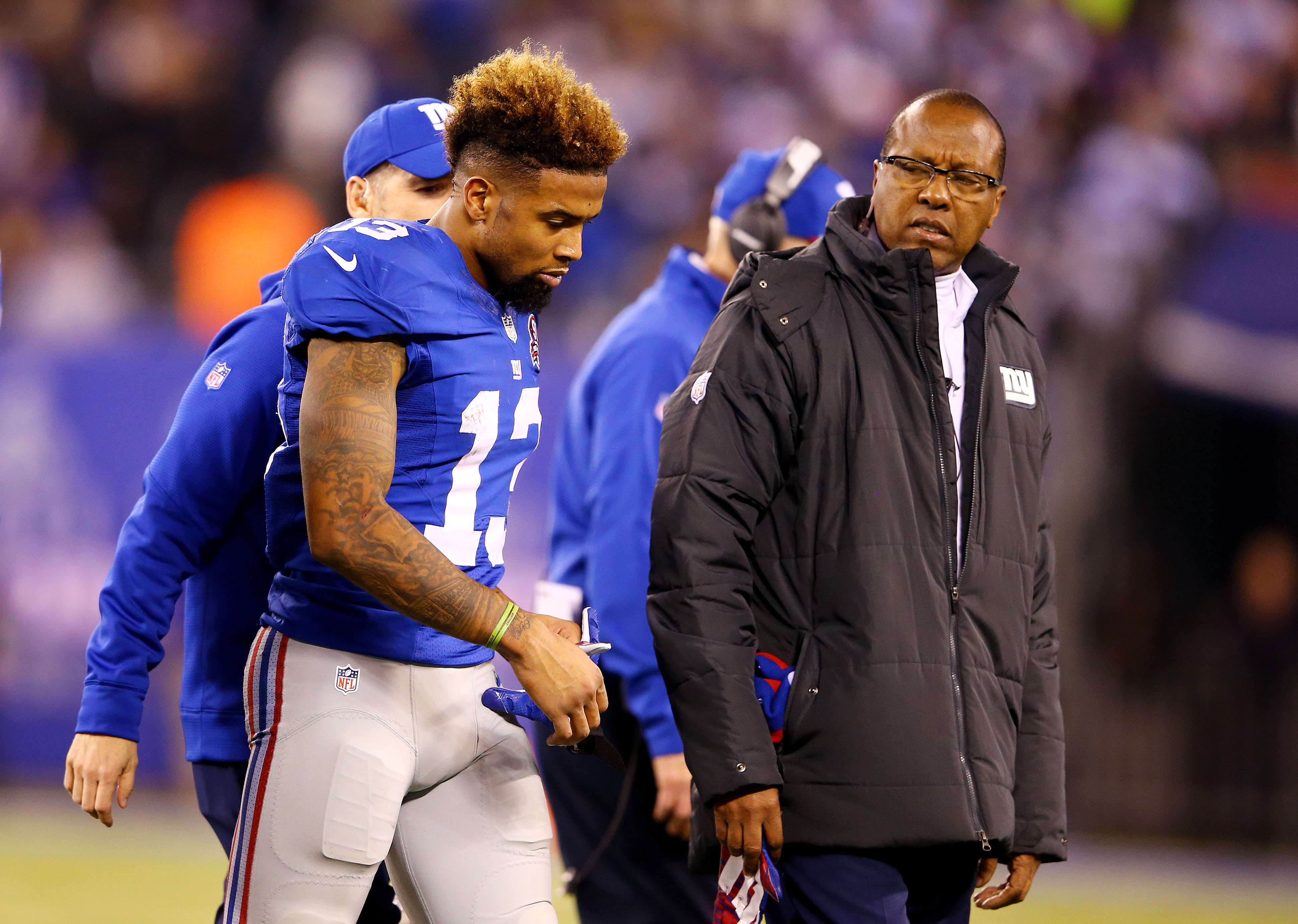 Odell Beckham leaves Sunday's game after being hit in the back