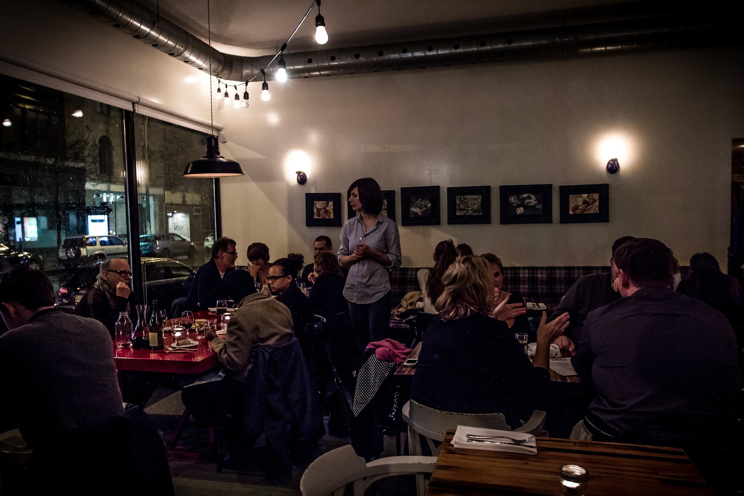 Sefi Amir surveys the tables at Lawrence