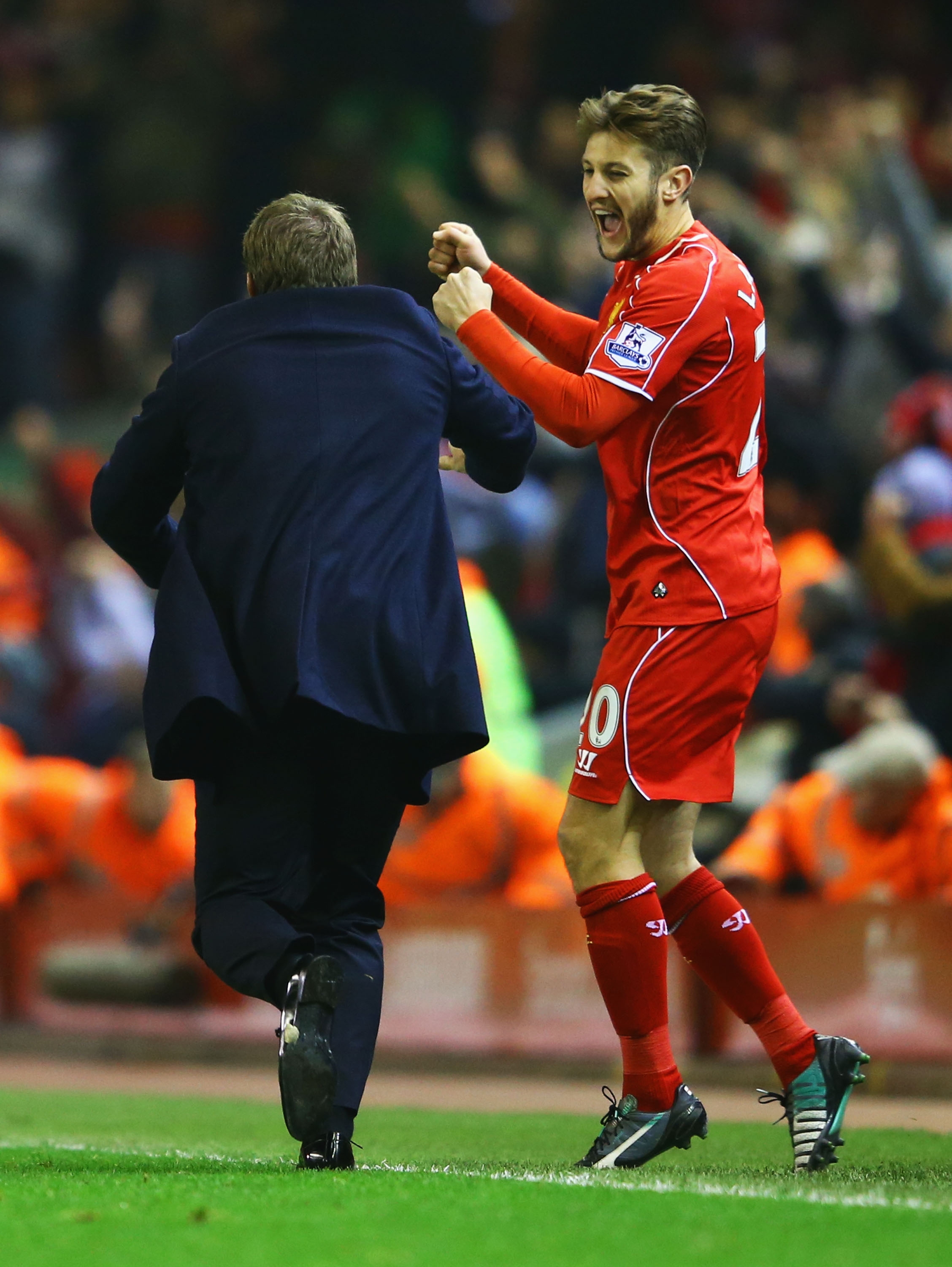 Brendan Rodgers and Adam Lallana celebrate Glen Johnson's goal.