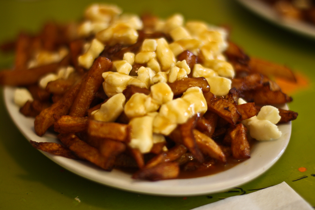 Poutine: French fries topped with cheese curds and slathered in gravy.
