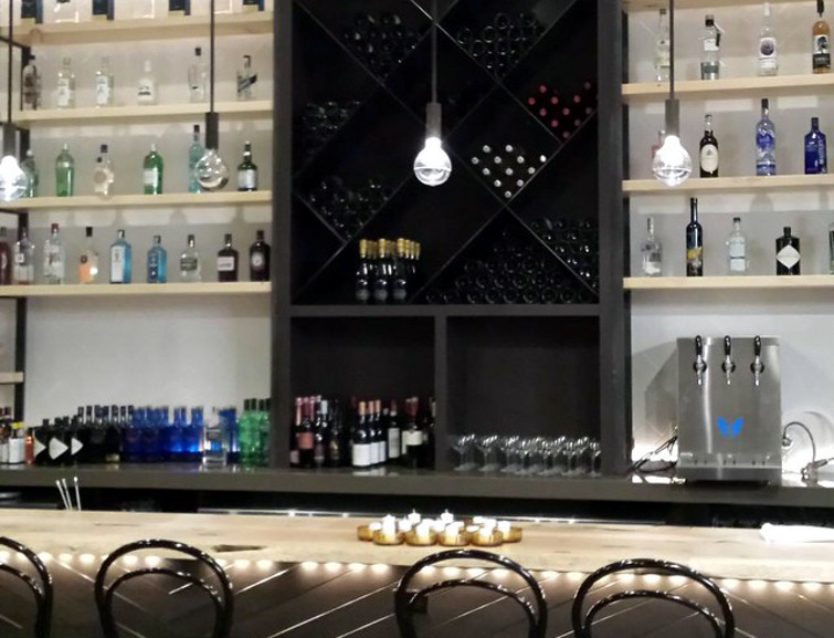 The bar at Juniper Commons, which will feature 150+ kinds of gin and housemade wine coolers.