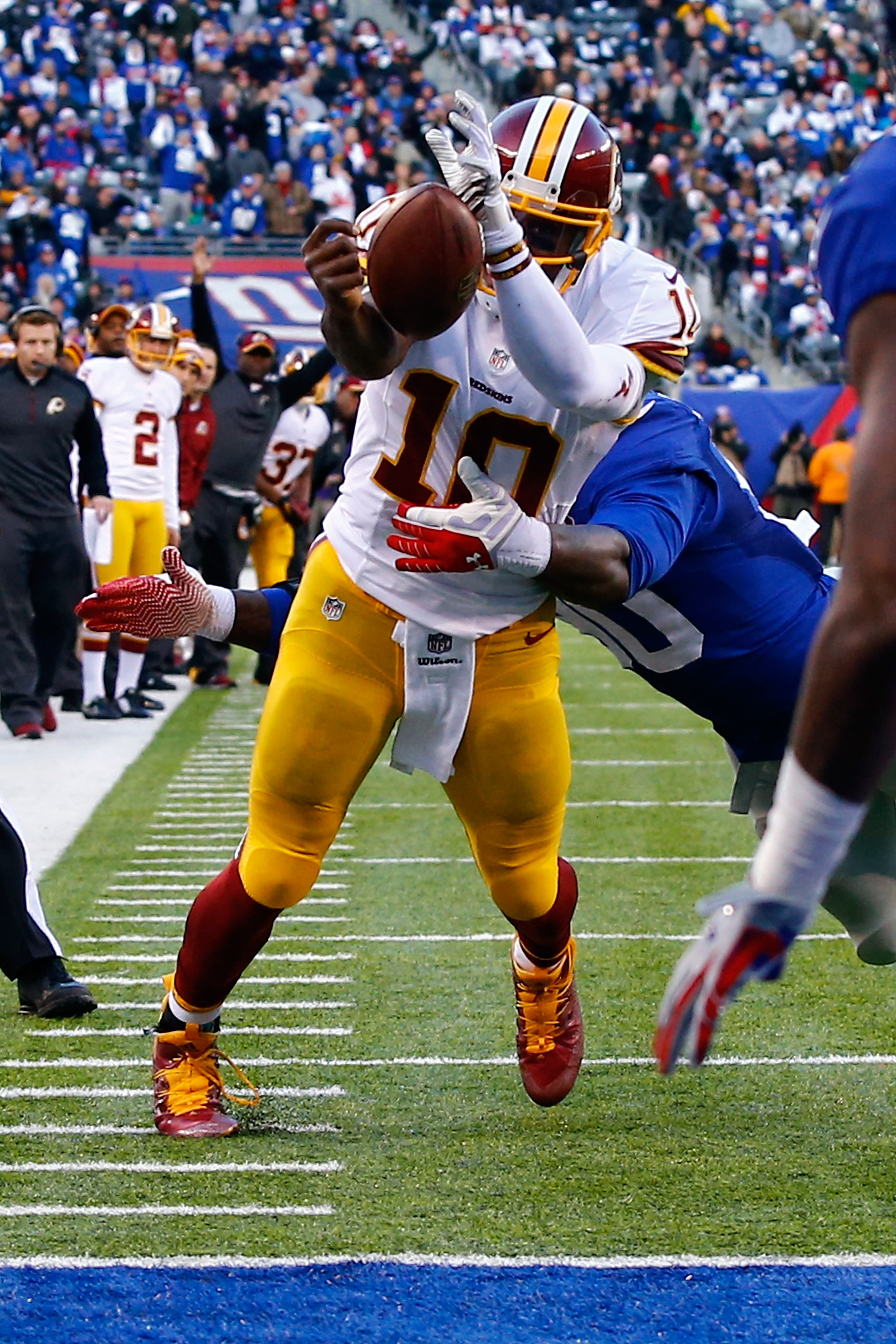 Robert Griffin III loses control of the ball as he cross the goal line