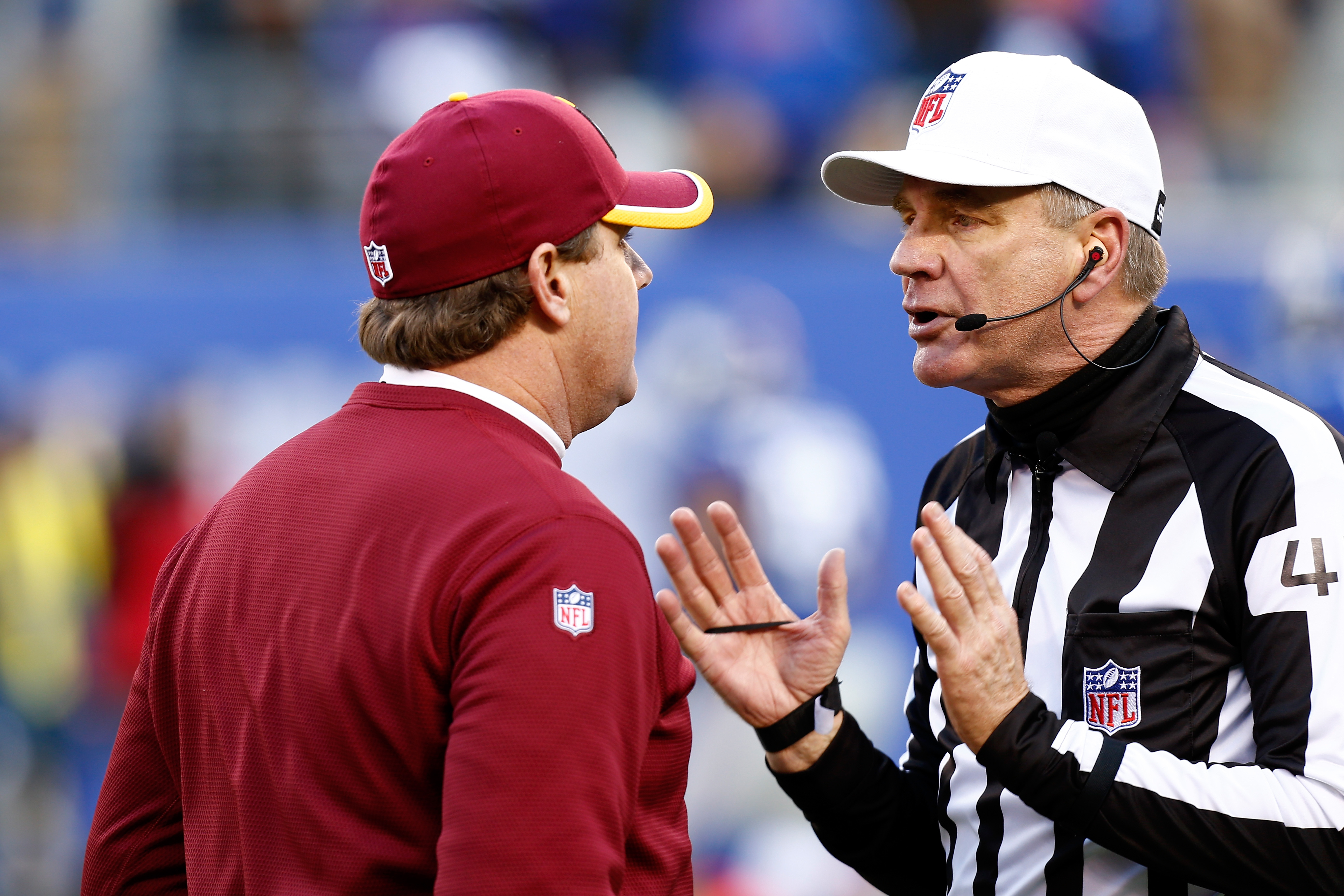 Jeff Triplette and Washington coach Jay Gruden discussing the end-of-the-half fumble by RGIII