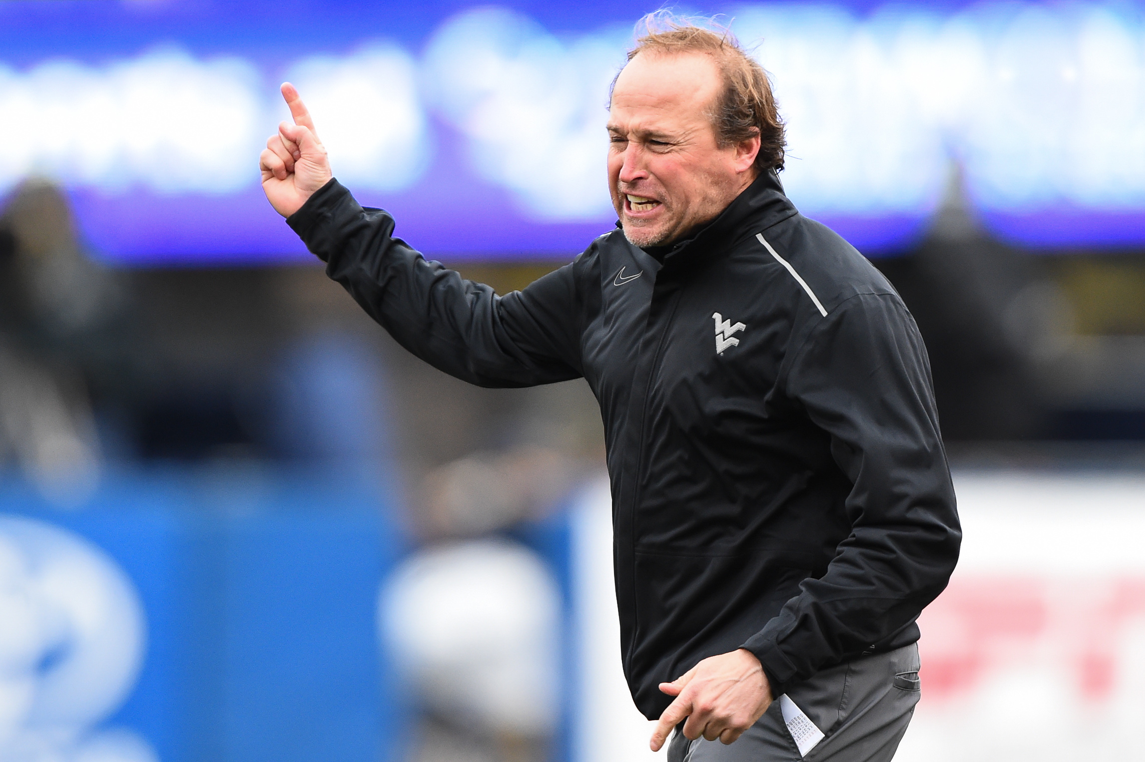 West Virginia head coach Dana Holgorsen reacts to the end of happy hour at a Morgantown Applebee's.