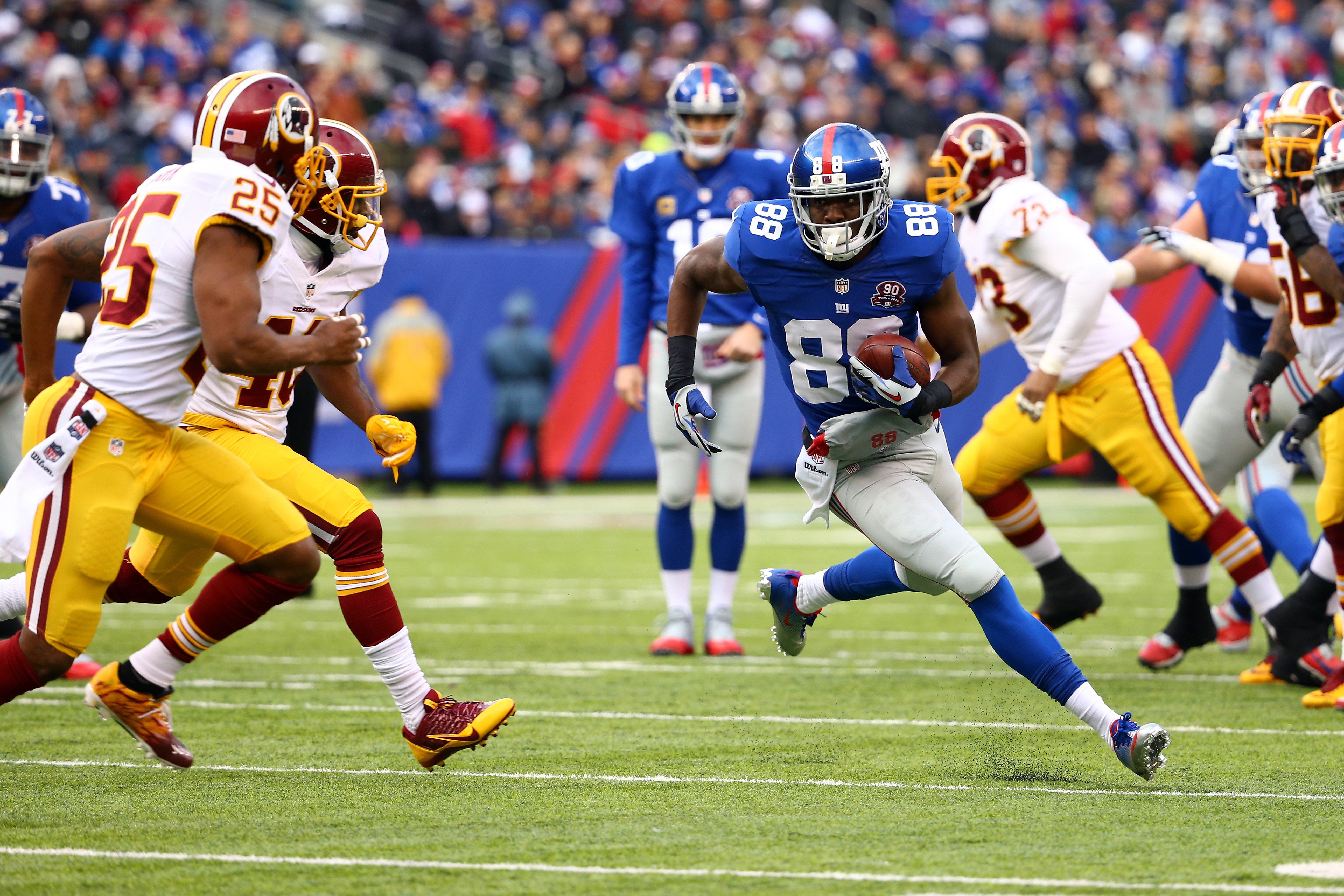 Corey Washington runs after making a catch against the Redskins on Sunday