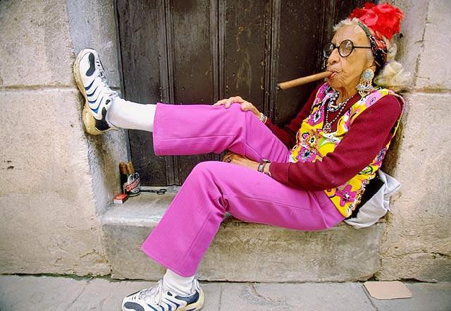 A Cuban woman smoking a cigar.