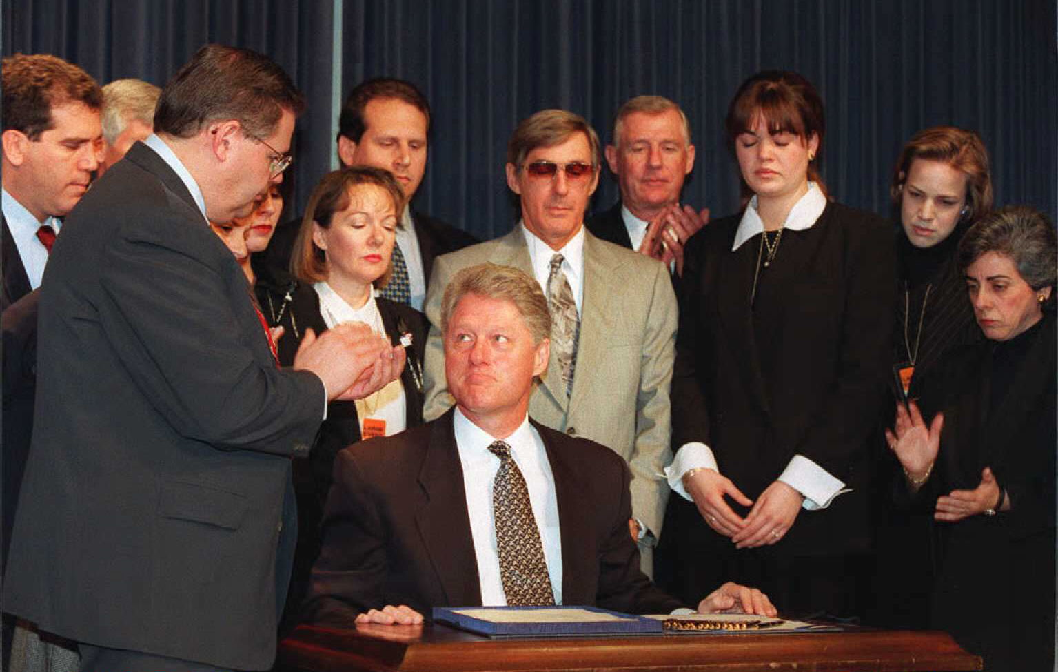 President Bill Clinton signs the Helms-Burton Act into law in 1996. The bill toughened the embargo on Cuba and restricted the president's power to end it.