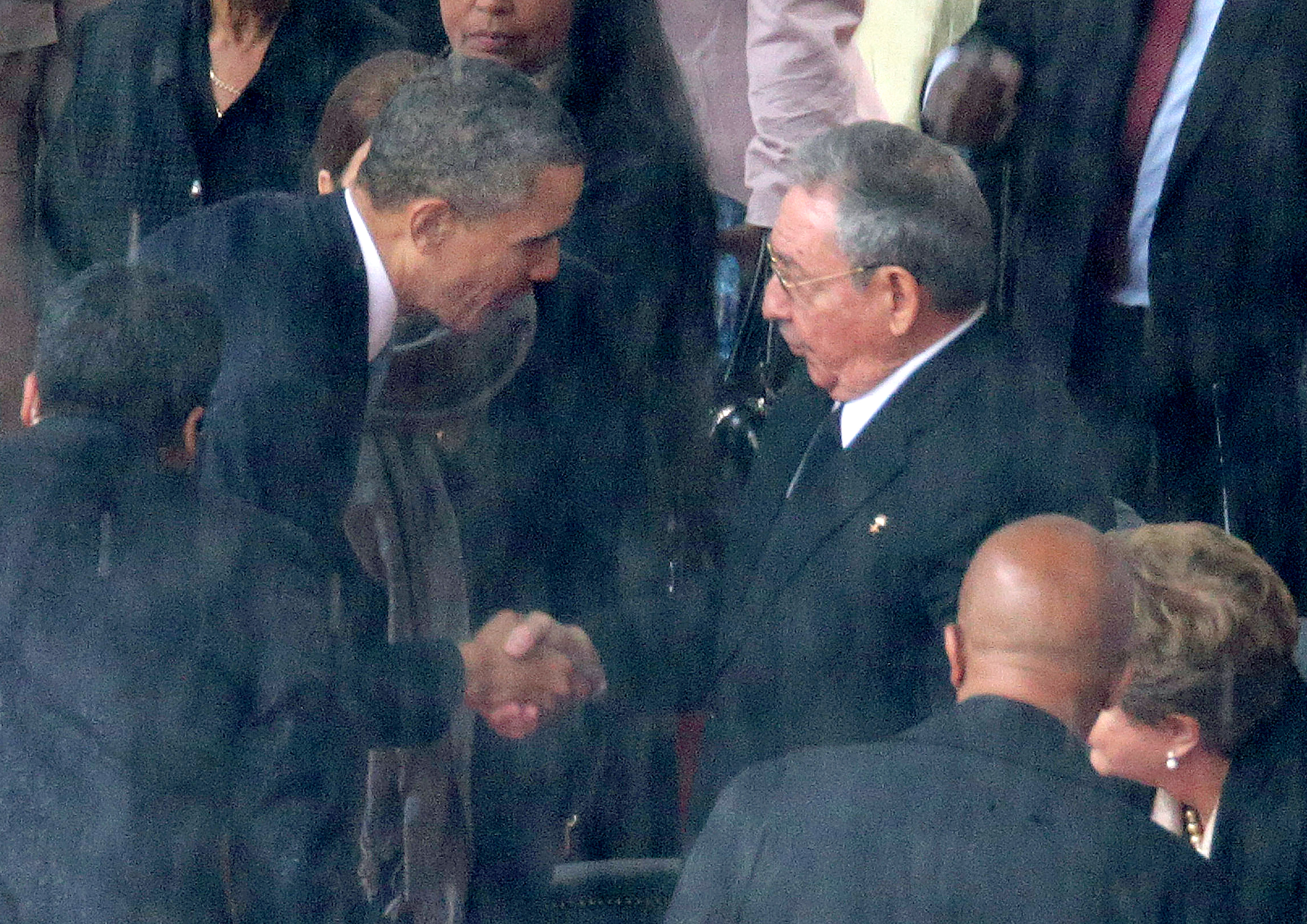 President Barack Obama shakes hands with Cuban President Raul Castro during the official memorial service for former South African President Nelson Mandela at FNB Stadium December 10, 2013 in Johannesburg, South Africa.