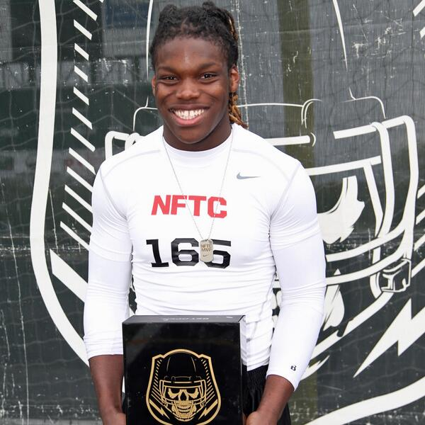 Malik Jefferson with his invite to The Opening