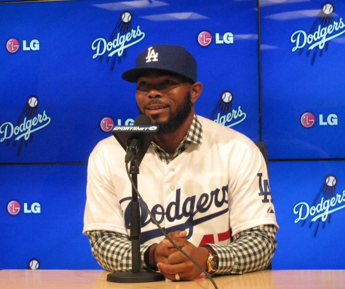 Howie Kendrick is introduced at a press conference at Dodger Stadium on Dec. 19, 2014.