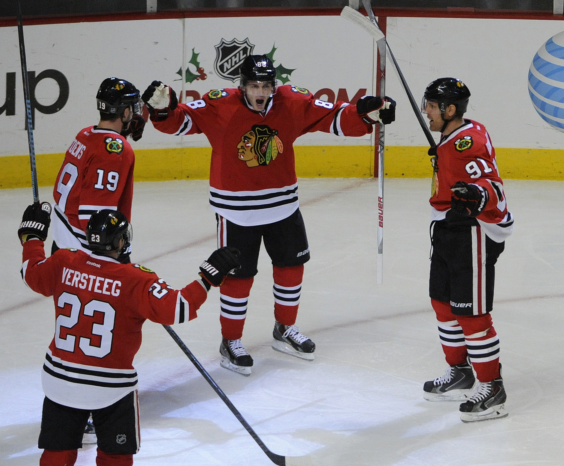The Hawks celebrate scoring a goal because it makes them happy.