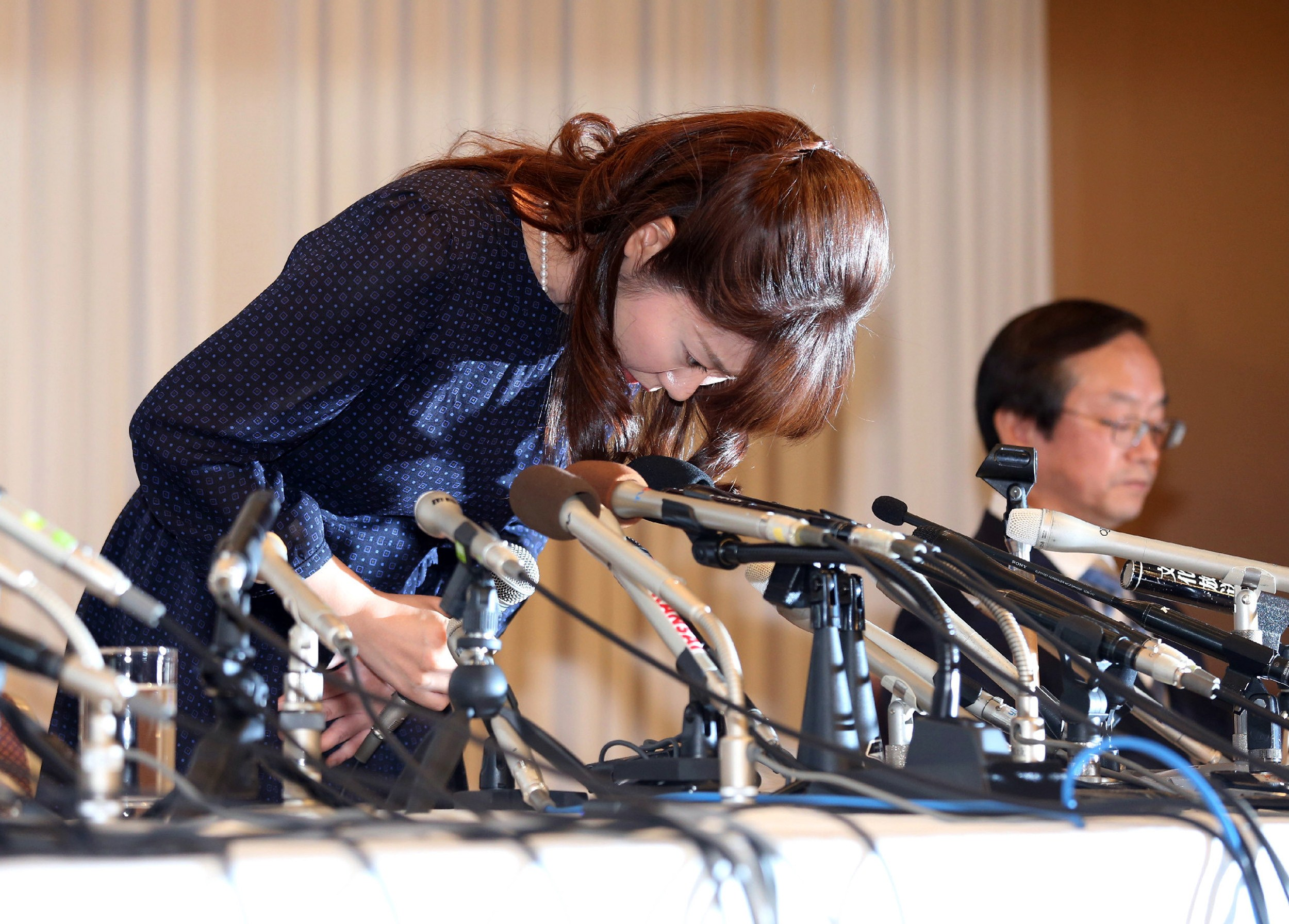 Haruko Obokata, a researcher at Japan's Riken Institute bows as she apologizes at a press conference in Osaka, Japan on April 9, 2014, following claims that her groundbreaking stem-cell study was fabricated