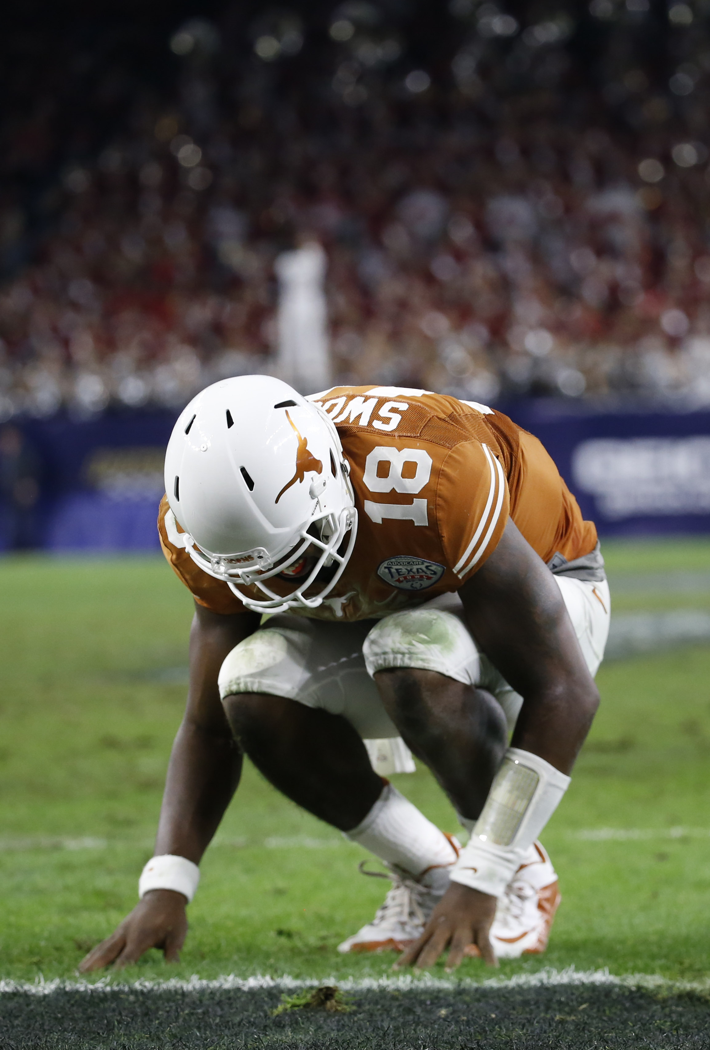 The UT QB covered more ground in this crouch than his team covered on most of their plays