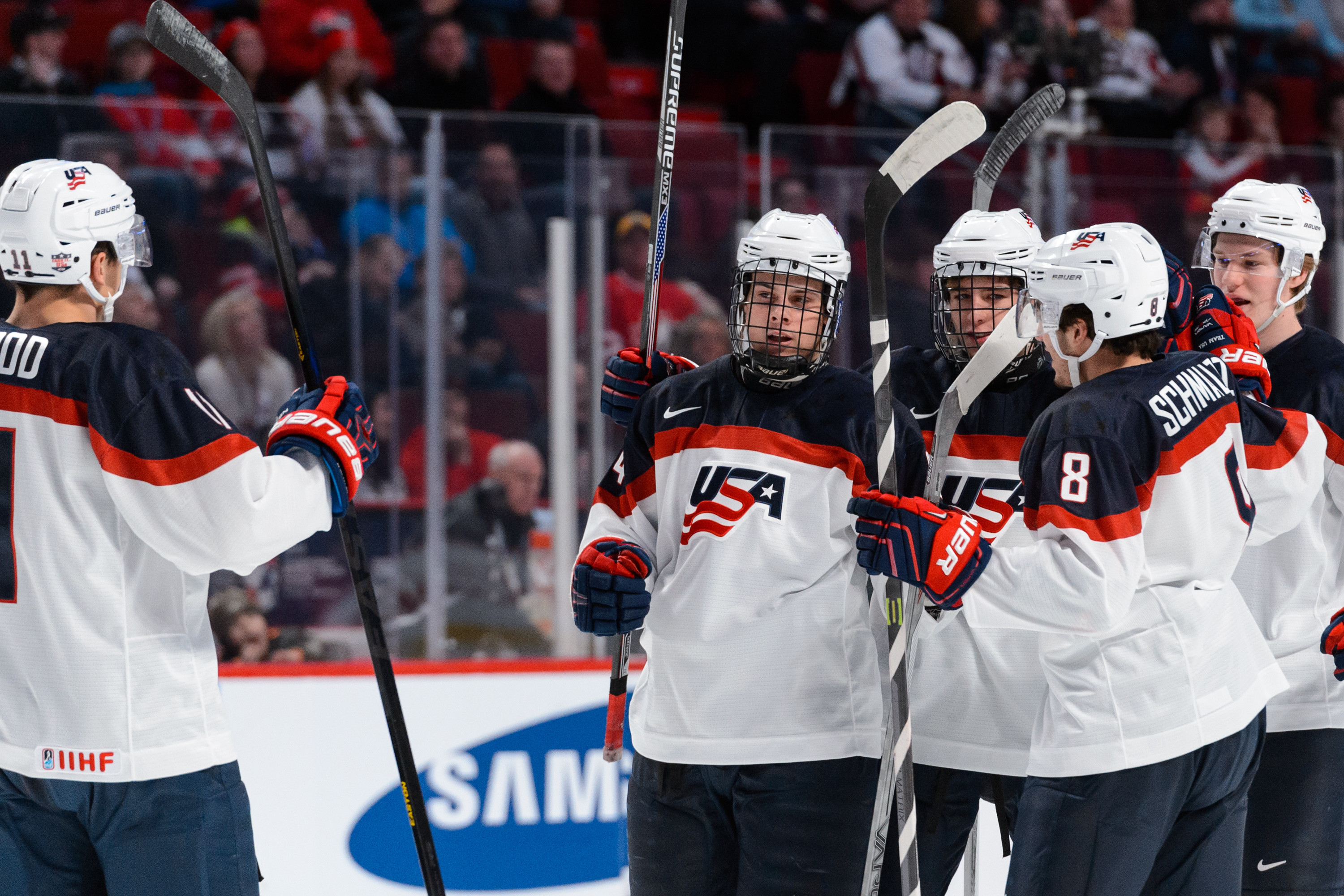 Auston Matthews and his teammates celebrate a goal against Germany.