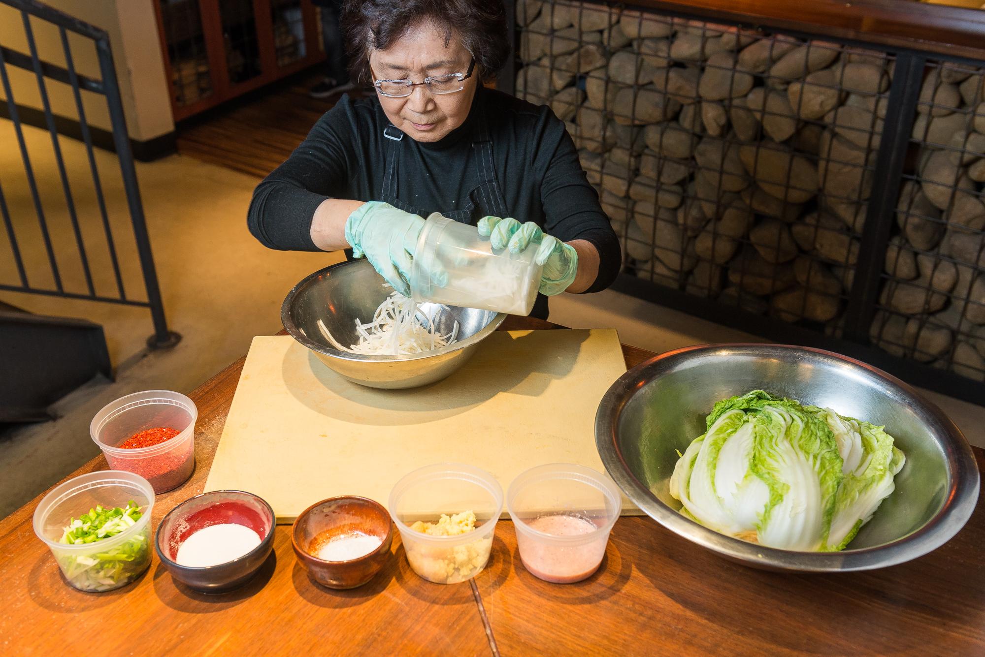 Yesoon Lee makes kimchi at Mandu.