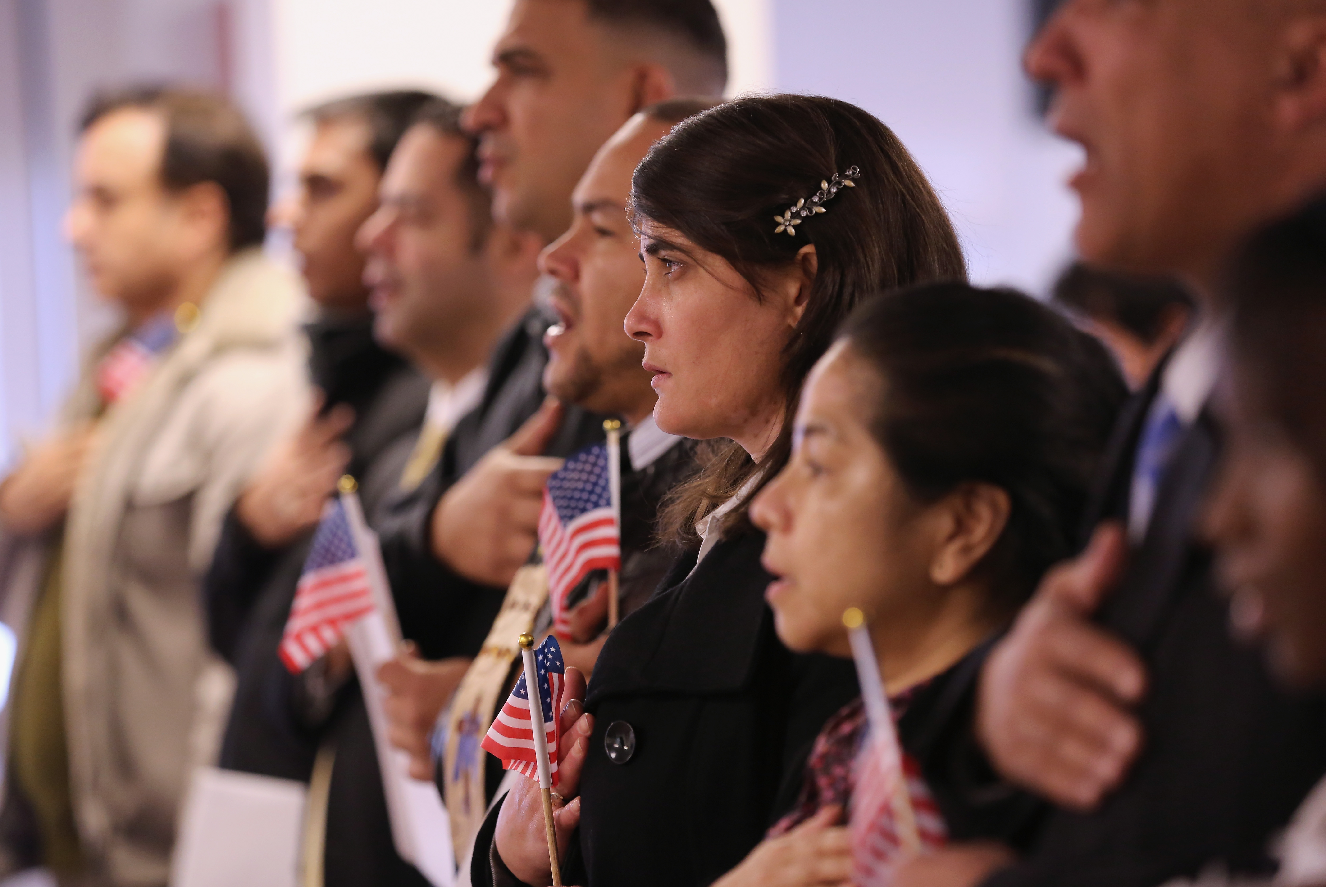 A group of brand-new American citizens taking the oath.
