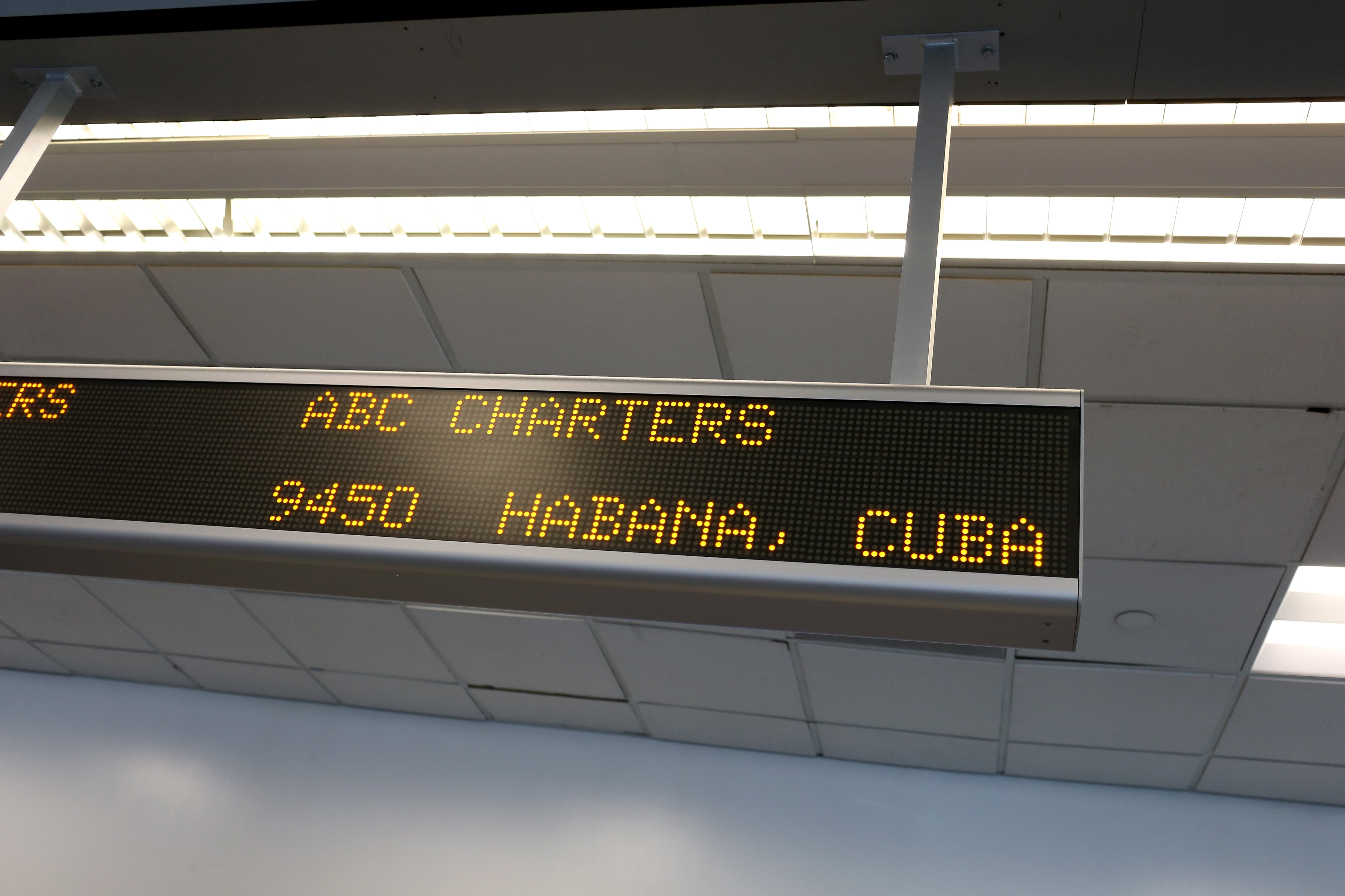 A sign indicates the ABC Charters American Airlines flight to Havana, Cuba at Miami International Airport on December 19, 2014 in Miami, Florida.