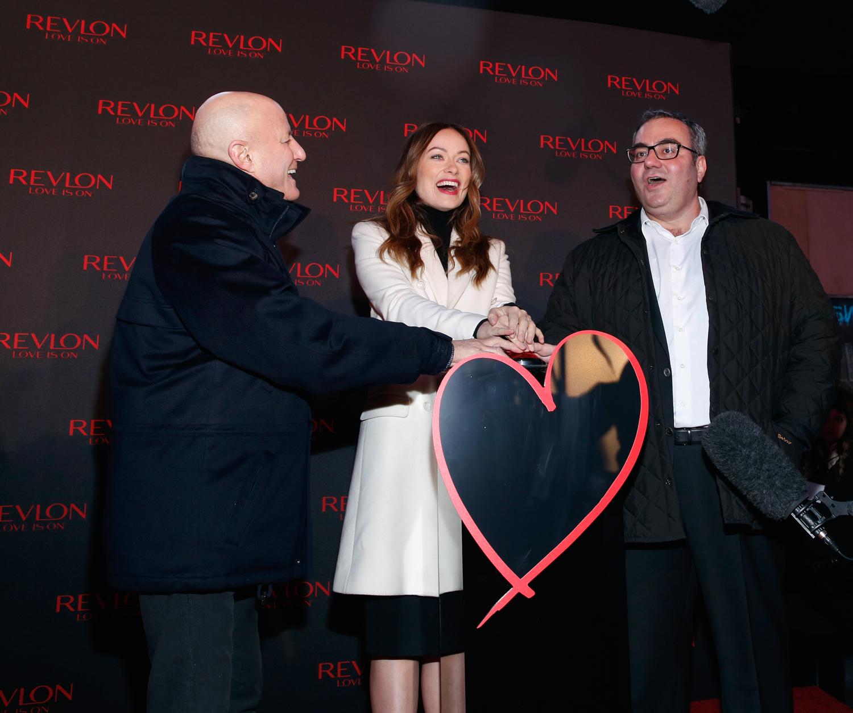 Ron Perelman, Olivia Wilde and Lorenzo Delpani at Revlon's Love Is On event. Photo: Getty