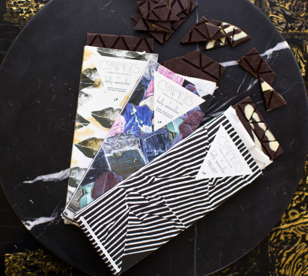 """Kelly Wearstler x Compartes chocolate bars, <a href=""""http://www.kellywearstler.com/on/demandware.store/Sites-KellyWearstler-Site/default/Search-Show?q=compartes"""">$13 each</a>."""