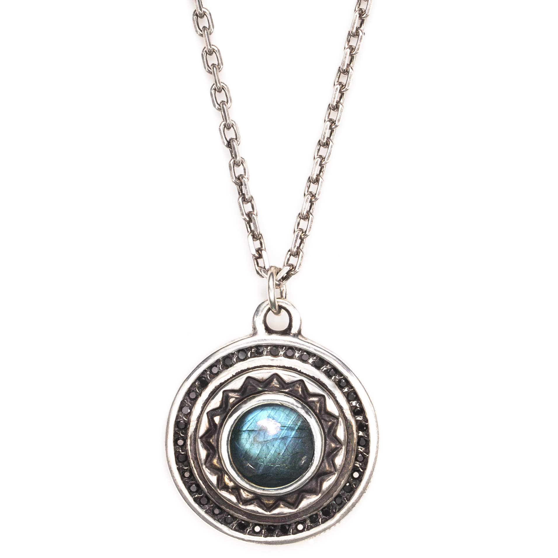 """<a href=""""http://www.pamelalovenyc.com/collections/pamela-love/products/web-exclusive-solar-pendant-in-sterling-silver-with-labradorite"""">Solar Pendant with labradorite and black spinel</a>, $375 (was $875)"""