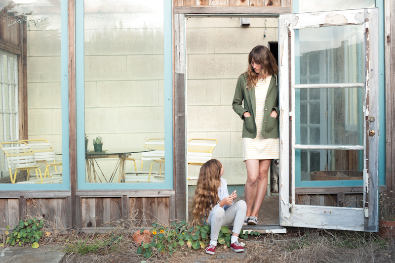 """Johanna St. Clair wears a Mollusk Surf Shop dress and jacket with her daughter Nina; photo by via <a href=""""http://www.mothermag.com/johanna-st-clair-mollusk-surf-shop/"""">Mother Mag</a>"""