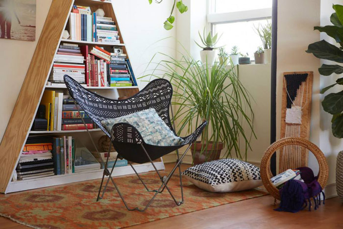 """Butterfly chairs: making lounging easy and standing difficult since whenever they were invented. Image via <a href=""""https://www.facebook.com/urbanoutfitters/photos/a.10152535767508798.1073741894.13473238797/10152535767683798/?type=3&amp;theater"""">Urb"""