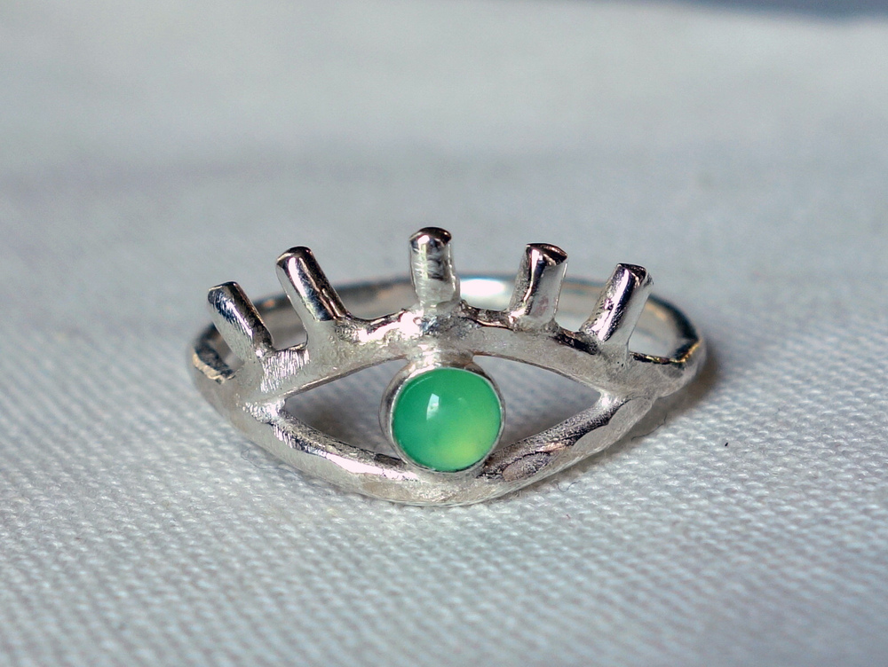 "Green Eye Ring with Eyelashes, <a href=""http://www.rachelpfeffer.com/product/green-eye-ring-with-eyelashes"">$112</a>"