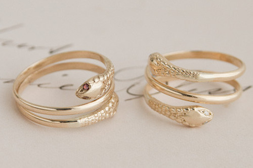 """<a href=""""http://ericaweiner.com/collections/1909-collection-view-all/products/double-headed-snake-ring#.U6sem160ZuY"""">Two-Headed Snake Rings</a> from the 1909 collection, starting at $360 with discount"""