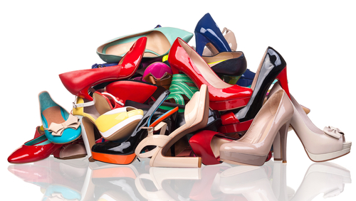 """Image via <a href=""""http://www.shutterstock.com/pic-129367985/stock-photo-pile-of-various-female-shoes-over-white.html/"""">Shutterstock</a>"""