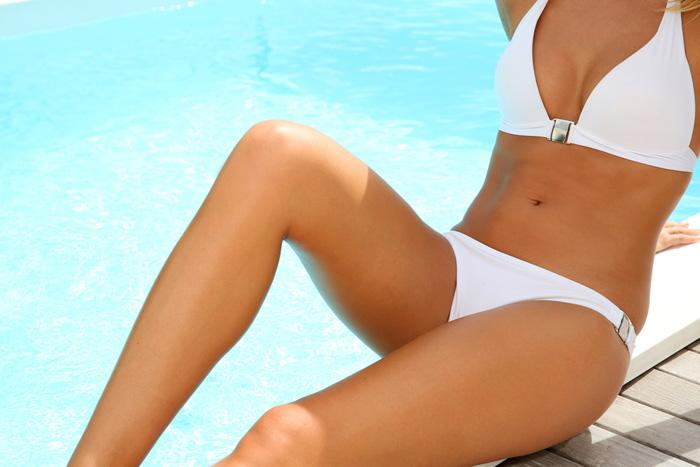 "Image via <a href=""http://www.shutterstock.com/pic-169712891/stock-photo-closeup-of-woman-s-body-in-white-bikini.html?src=Xl9Qg17nEE6wIkkmKrmkog-1-55"">Shutterstock</a>"
