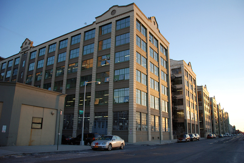 """Industry City; Photo by Nathan Kensinger via <a href=""""http://ny.curbed.com/archives/2013/12/20/sunset_park_industrial_stronghold_spurs_neighborhood_change.php"""">Curbed NY</a>"""