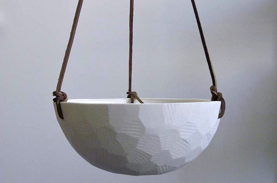 """Geo Porcelain Hanging Planters, <a href=""""https://www.sprouthome.com/shop/containers-terrariums/faceted-hanging-planters"""">from $39.00</a> at Sprout Home"""